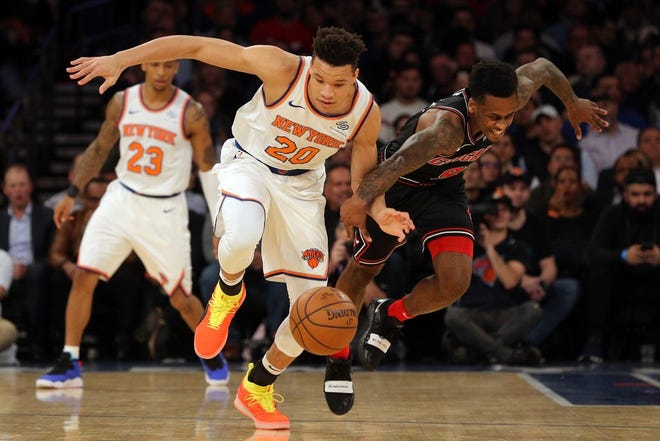 New York Knicks forward Kevin Knox (20) drives around Toronto Raptors forward OG Anunoby (3) as Raptors guard Lorenzo Brown (4) looks on during second half NBA basketball action in Toronto on Saturday, Nov. 10, 2018.