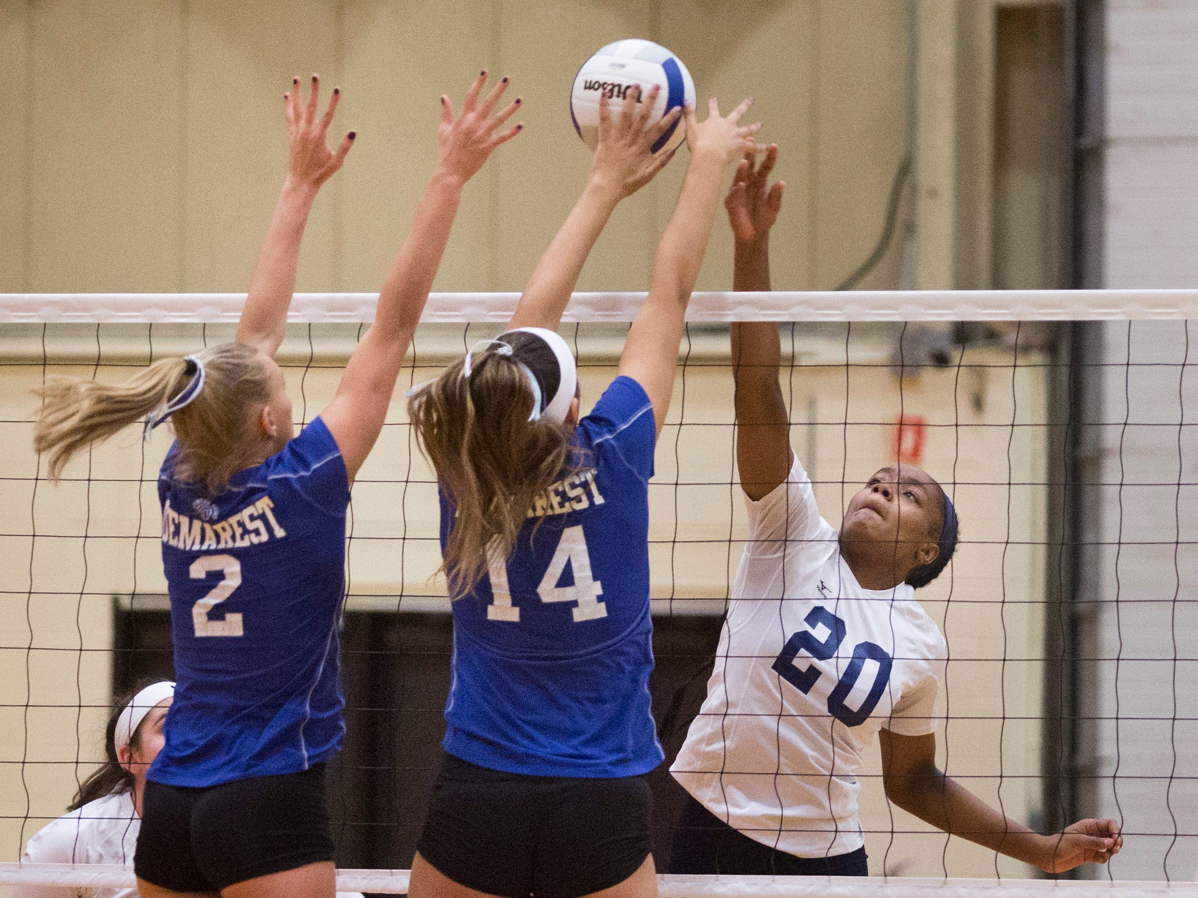 Northern Valley Regional at Demarest's Sydney Woods (2) and Gianna Arias (14) attempt to block against Rutherford High School's Abby Verderber (20) during the NJSIAA volleyball group two finals at William Paterson Recreation Center. Demarest won 25-13, 25-9.