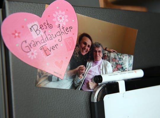 A photo of Amanda Carlson and her grandmother Agatha Beaupre sits on Carlson's fridge with a magnet sent to her by her grandmother in her Morristown home on Sunday, Nov. 11, 2018.