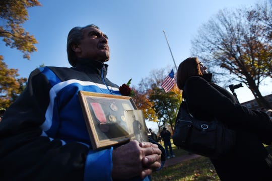 Al Masullo of Hackensack holds a photo and medals of his grandfather, Alfredo Masullo wo served in World War I, as Al listens to a speaker during the Memorial service to commemorate the Centennial of the First World War, at Van Nest Square in Ridgewood on 11/11/18.