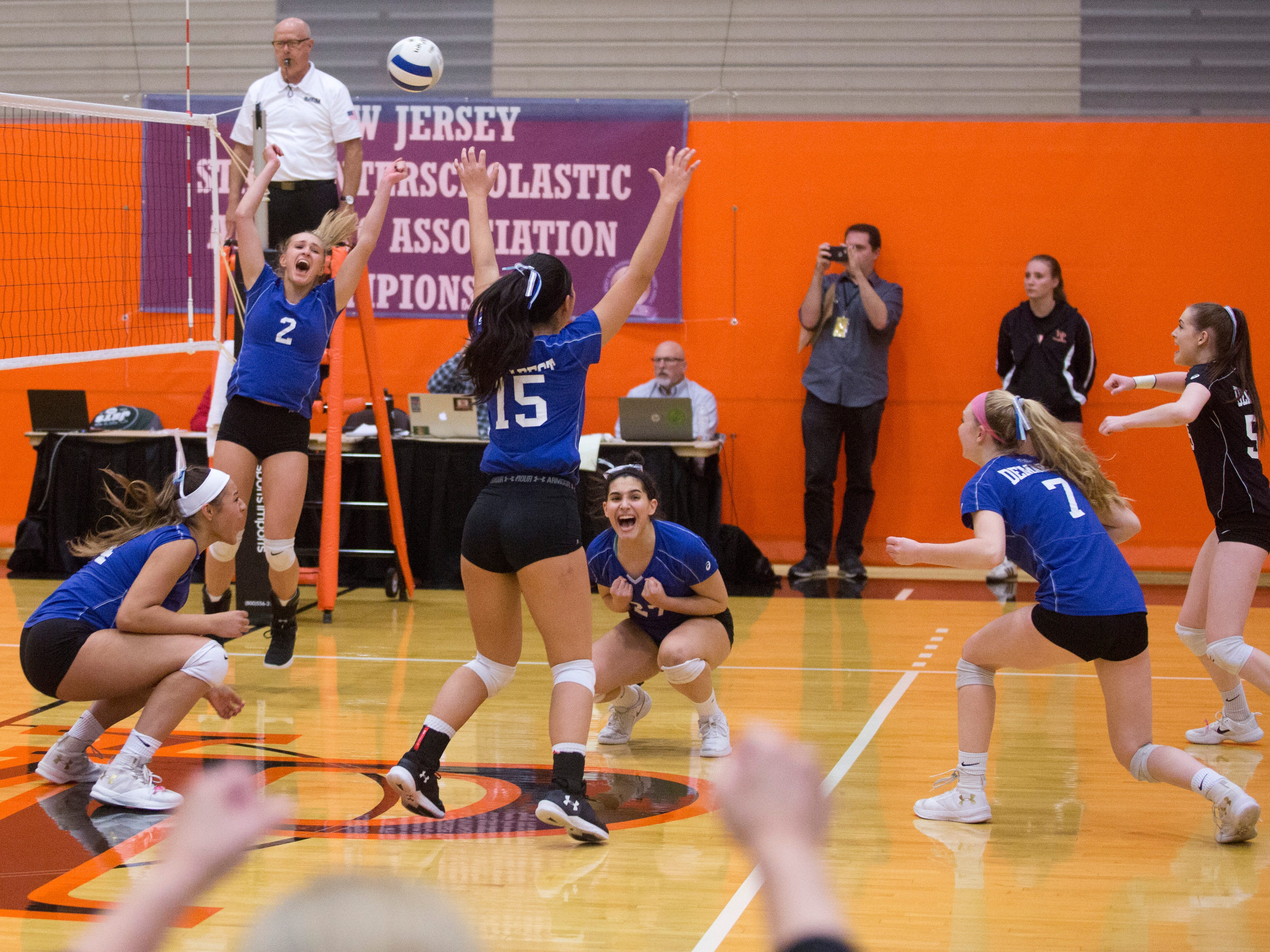 Northern Valley Regional at Demarest celebrates after winning the NJSIAA volleyball group two finals at William Paterson Recreation Center. Demarest won 25-13, 25-9.