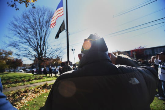 Peter Mancuso, former resident of Elmwood Park, who served in the Korean War, salutes as the flag is raised during the Memorial service to commemorate the Centennial of the First World War, at the Boro Field in Elmwood Park on 11/11/18.
