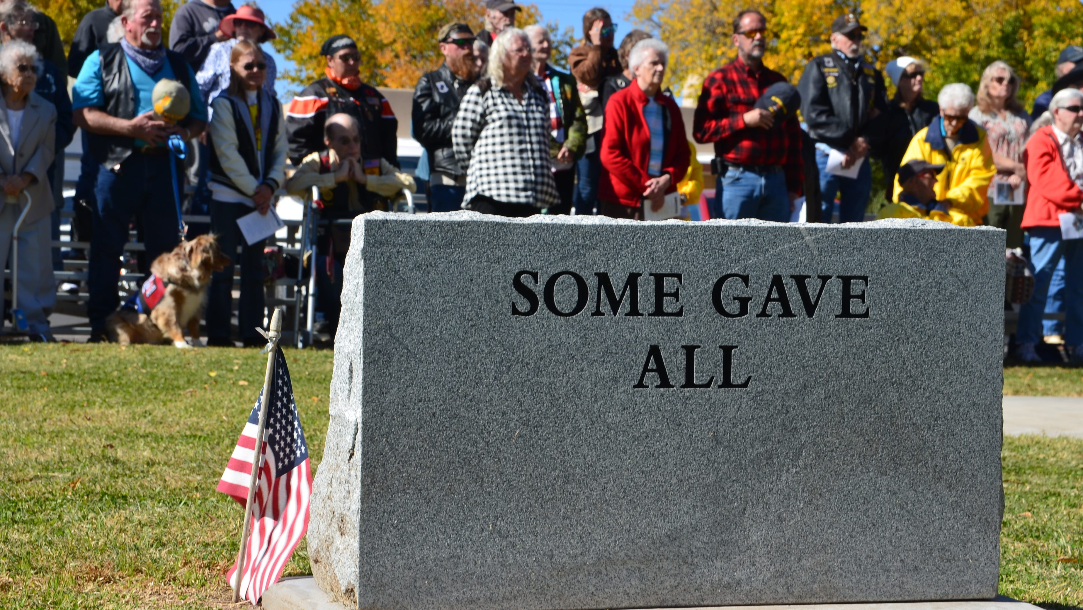On the back of a monument located at Veterans' Park states: Some Gave All.