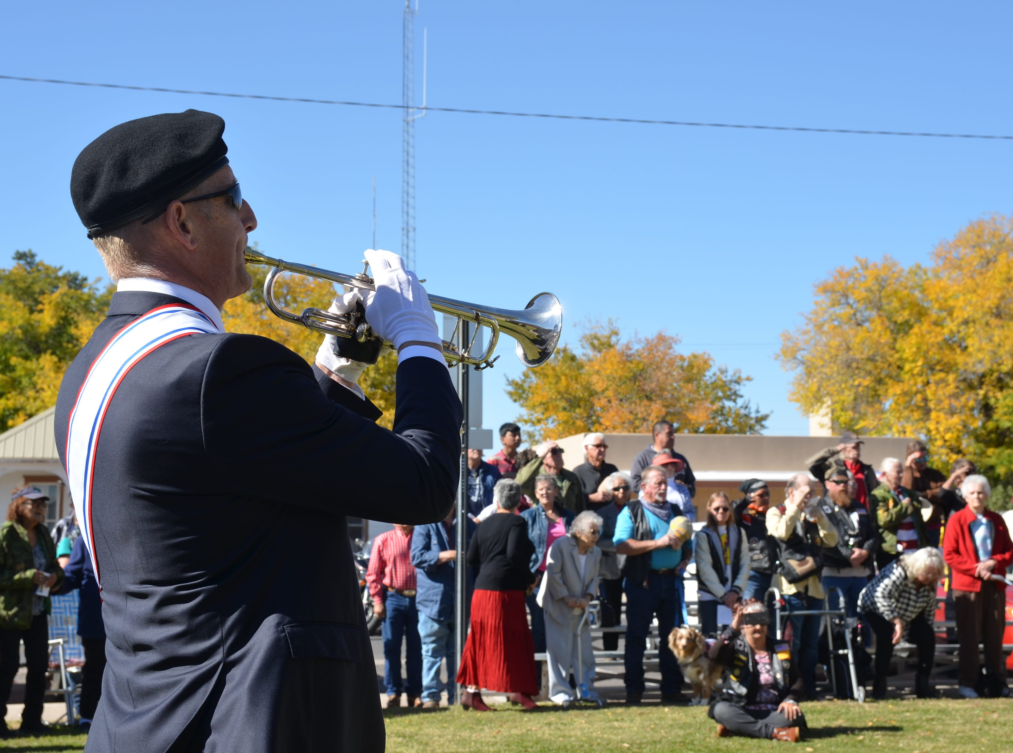 Matthew Seltzer performs Echo Taps, a bugle call usually conducted at flag ceremonies and sometimes at military funerals.