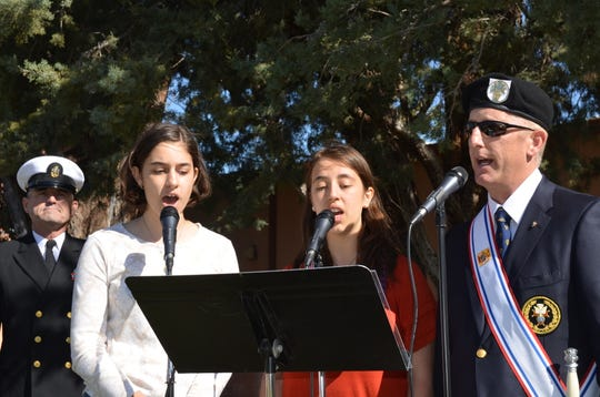 Left, Rebecca, Maria and Matthew Seltzer sang America the Beautiful.
