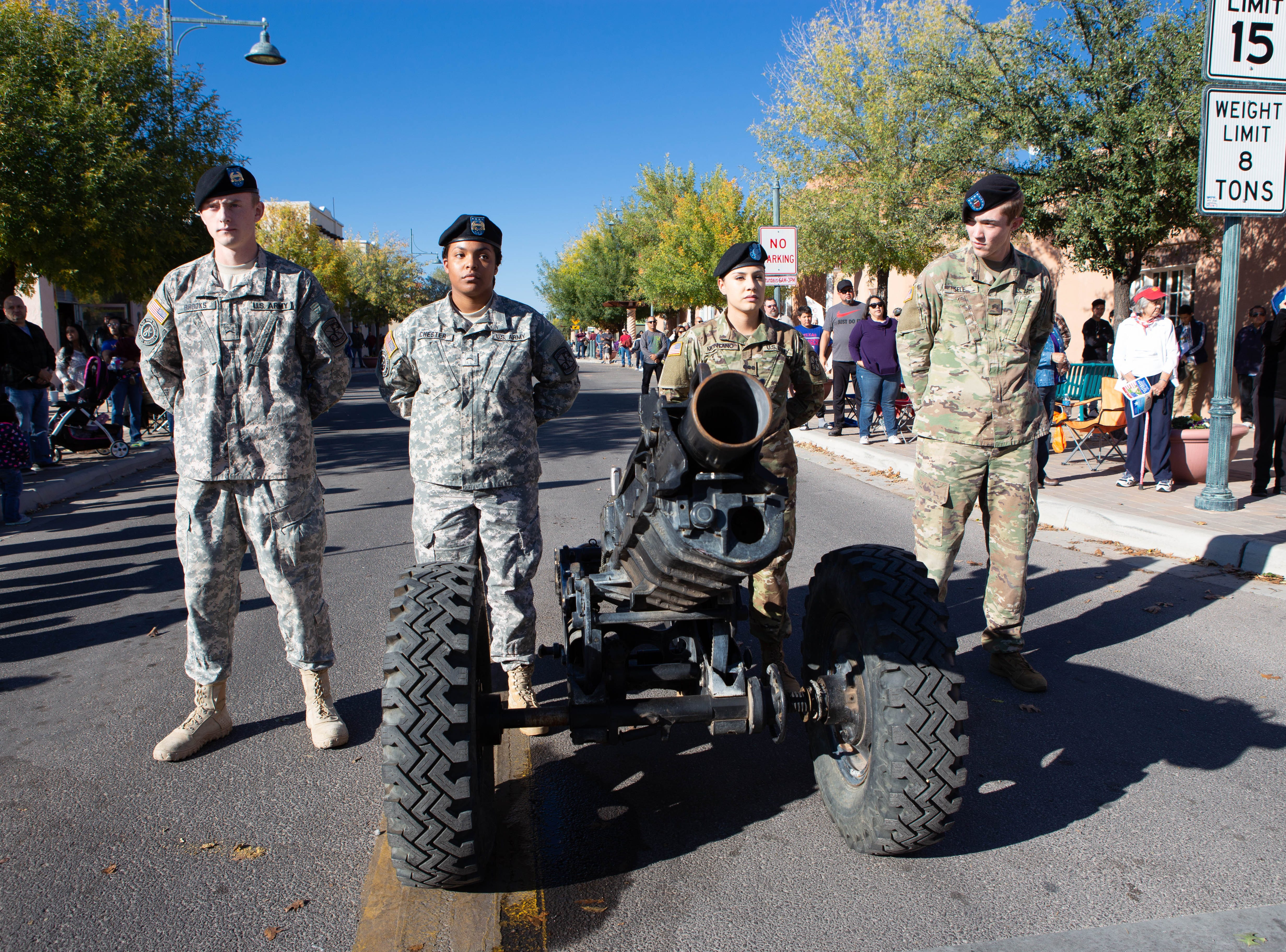 NMSU Bataan Batallion members, left to right, Kabel Brooks, Cynthia Chester, Karlene Montano, and Jacob Sell stand at the ready with the canon awaiting the start of the Veterans Day parade on Nov. 10, 2018.