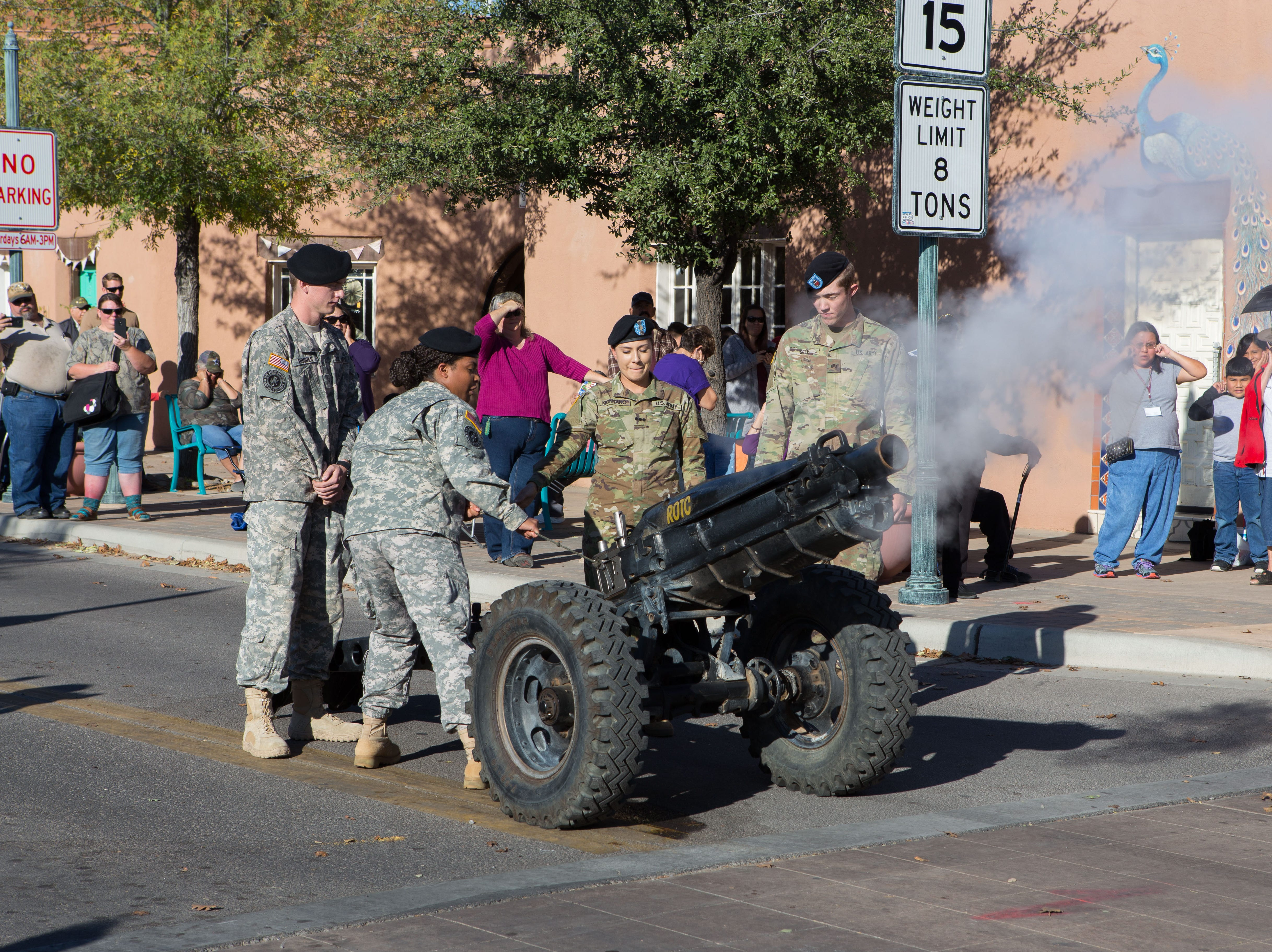 Members of NMSU Bataan Batallion fire the canon to signify the start of the Veterans Day Parade  held on November 10, 2018.