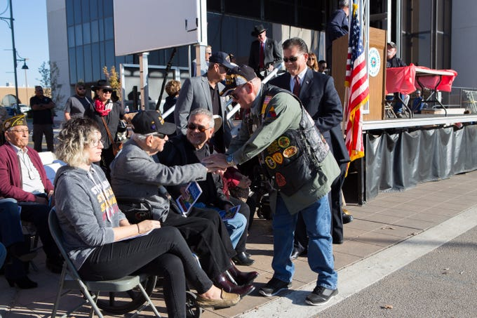 Vietnam Veteran Chaplain Lawrence Orvis greets 100-year-old WWII veteran Arthur Flores during the Veterans Day Parade on November 10, 2018.
