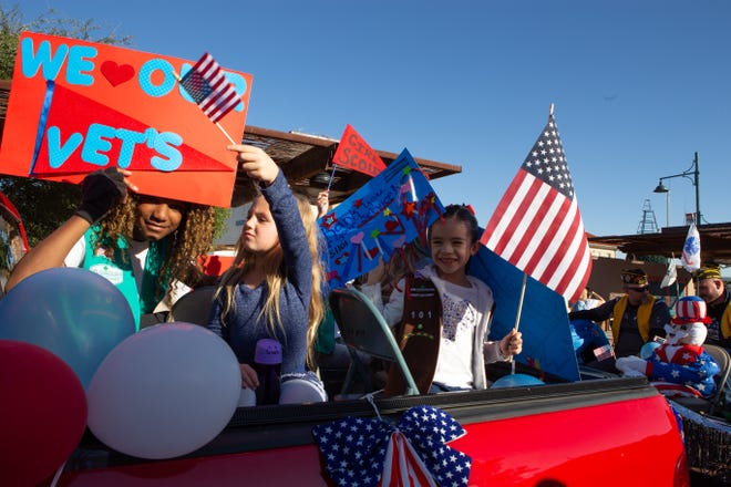 Girl Scout Troop 51101 members from left, Alyssa Burton, 10, Brylee Vaughn, 6, and Olivia Amezquita, 7 supporting veterans during the Veterans Day Parade held on November 10, 2018.
