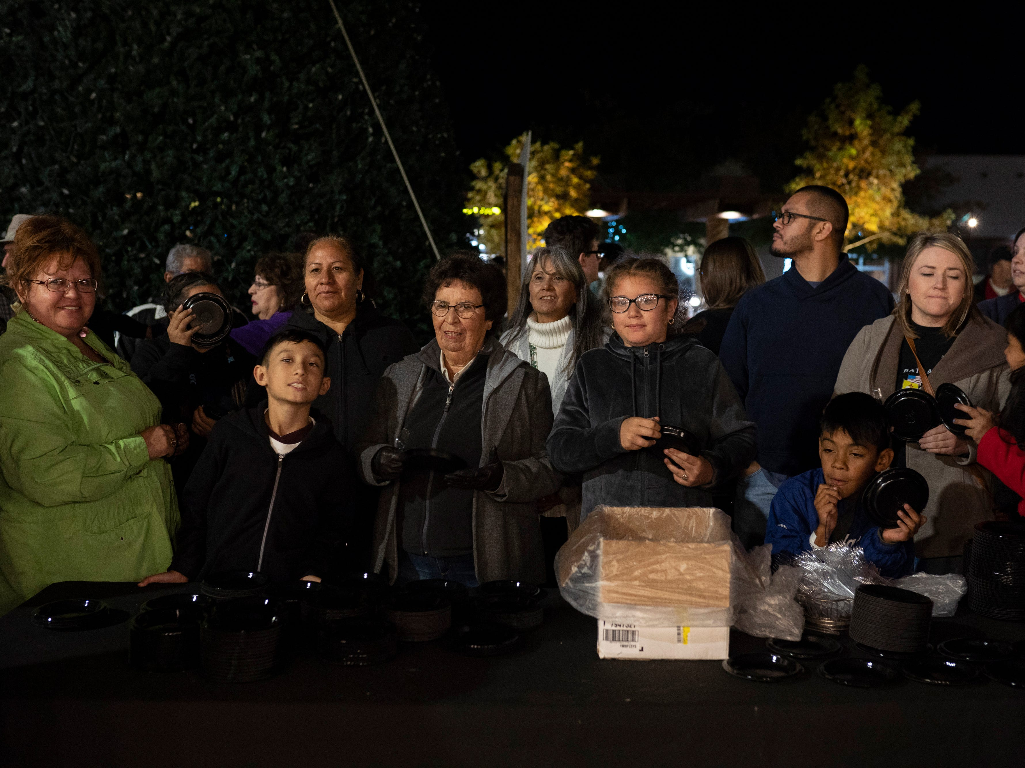 Attendees wait for their chance to eat part of the record-setting serving of nachos at Noche de Nachos. Las Cruces unofficially set the record for world's largest serving of nachos Saturday, Nov. 10, 2018, in downtown Las Cruces.