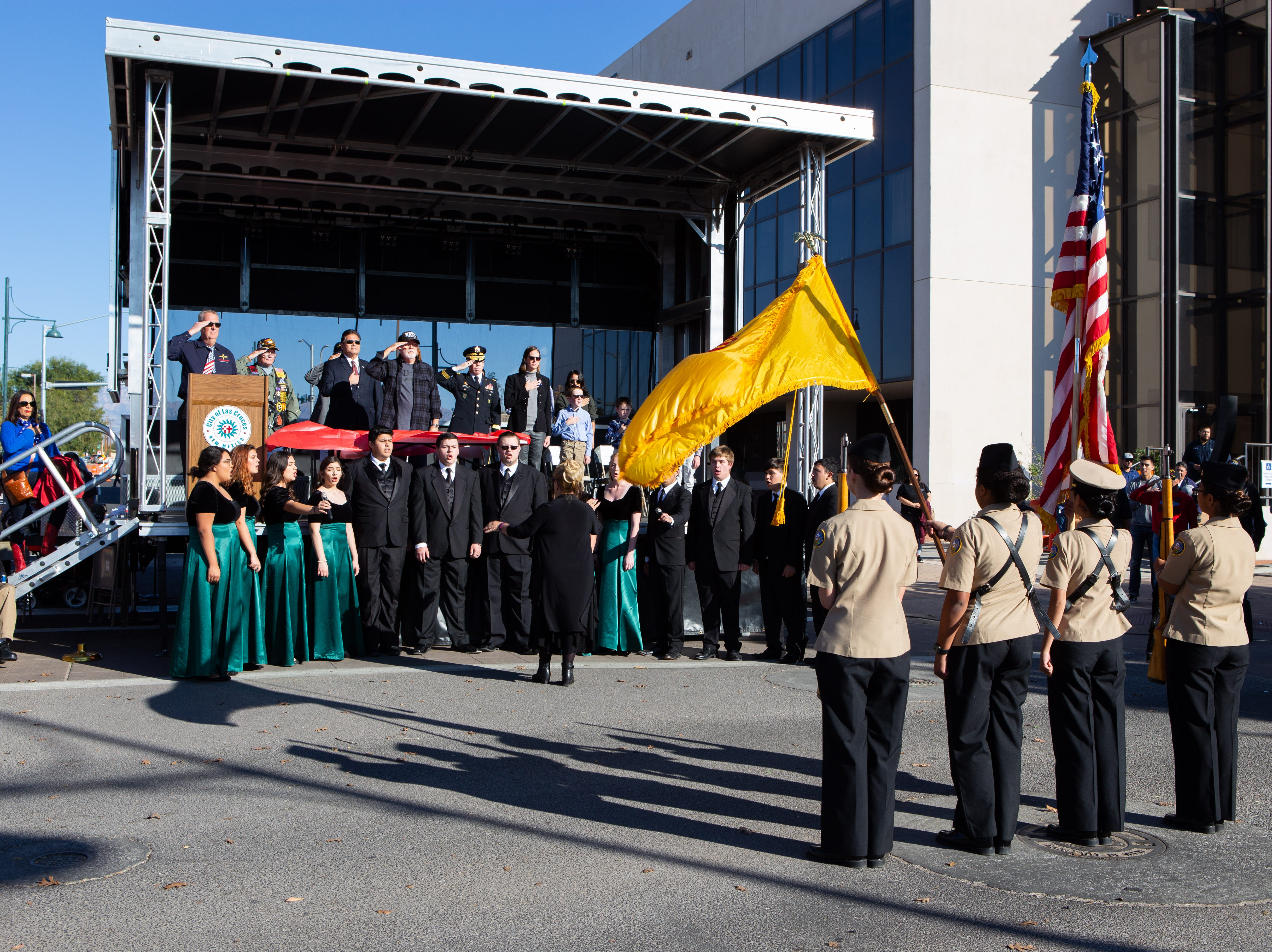 Mayfield High School Madrigal Singers sing the anthem as the colors are presented by the Onate High School Navy JROTC. The Veterans Day Parade was held on November 10, 2018.