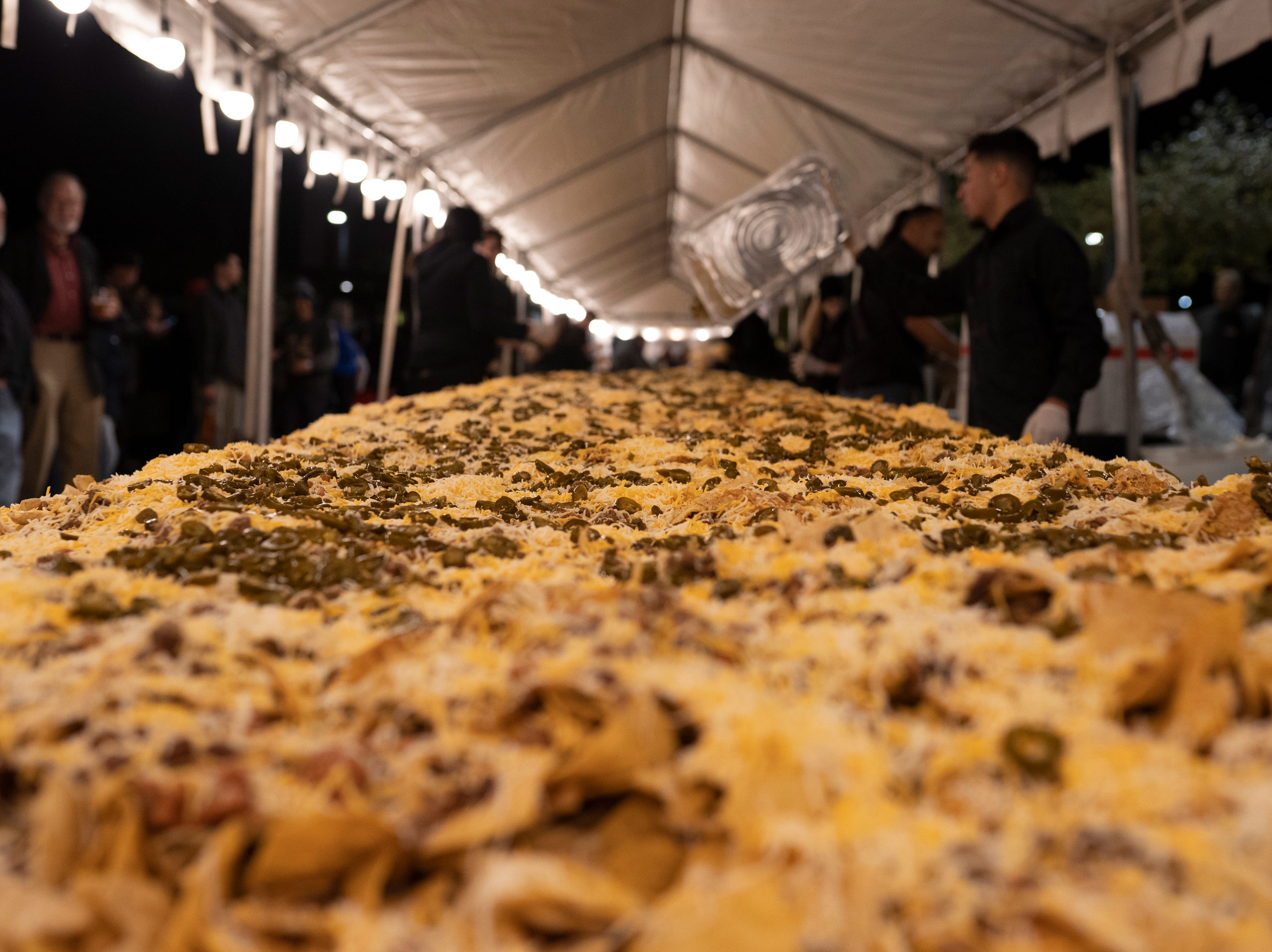 The 5,039-pound, 110-foot nachos made Saturday, Nov. 10, 2018, in downtown Las Cruces unofficially set the record for world's largest serving of nachos.