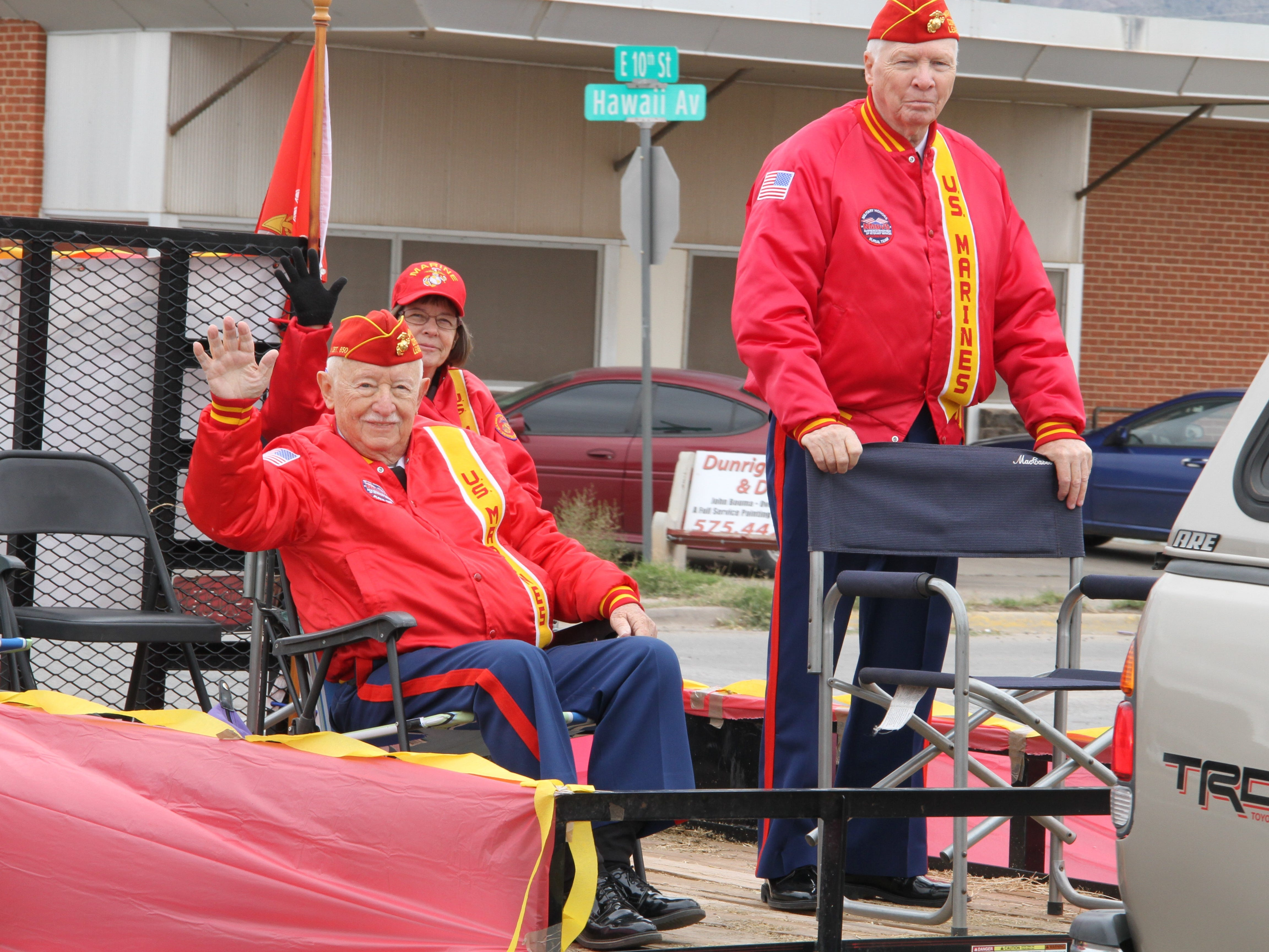 U.S. Marine Corps veterans waive to the crowd during the Alamogordo Veterans Day Parade Saturday.
