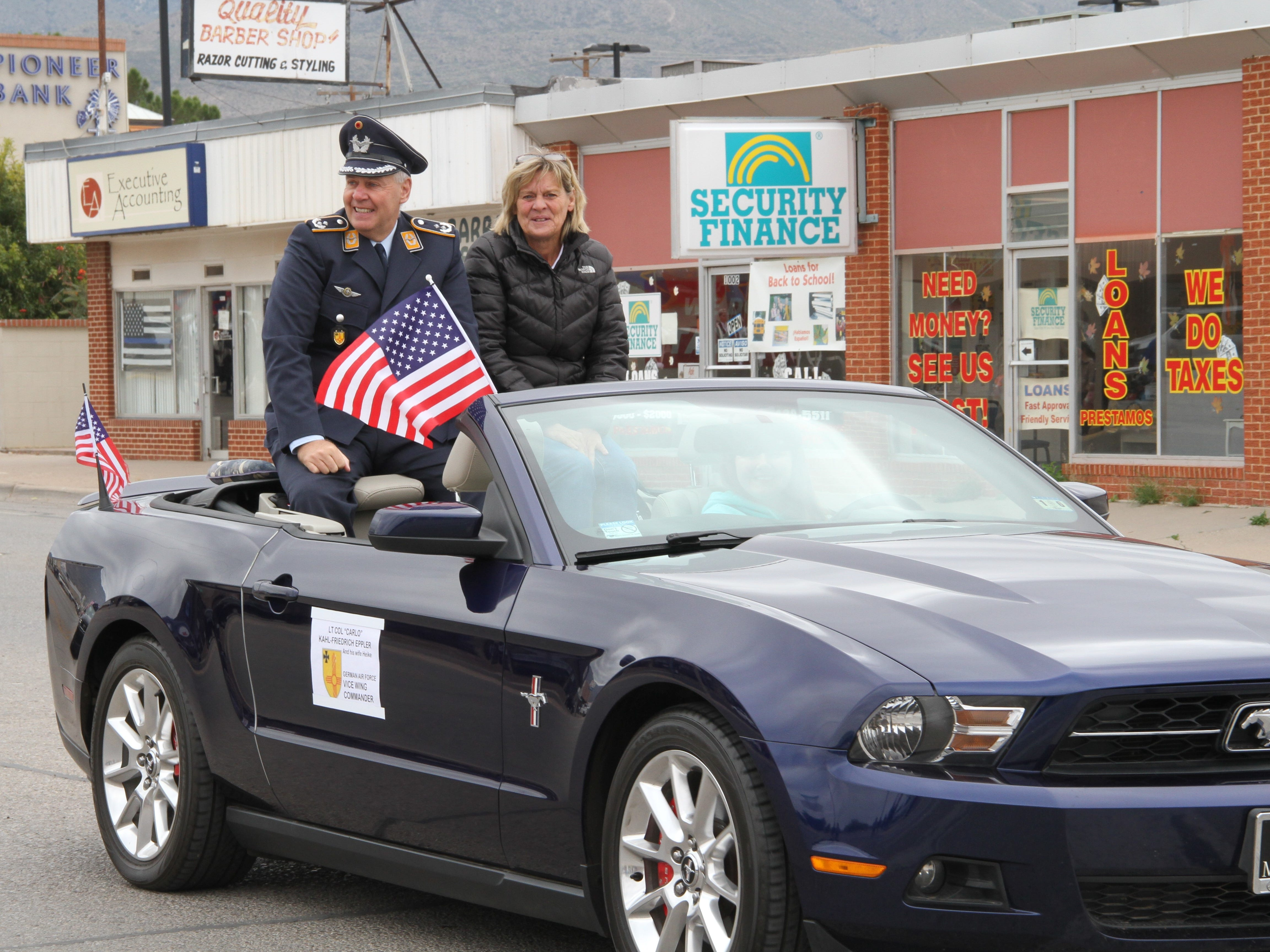 "German air force Vice Wing Commander Lt. Col. ""Carlo"" Kahl-Friedrich Eppler and his wife Heike smile to the crowd during the Alamogordo Veterans Day Parade Saturday."