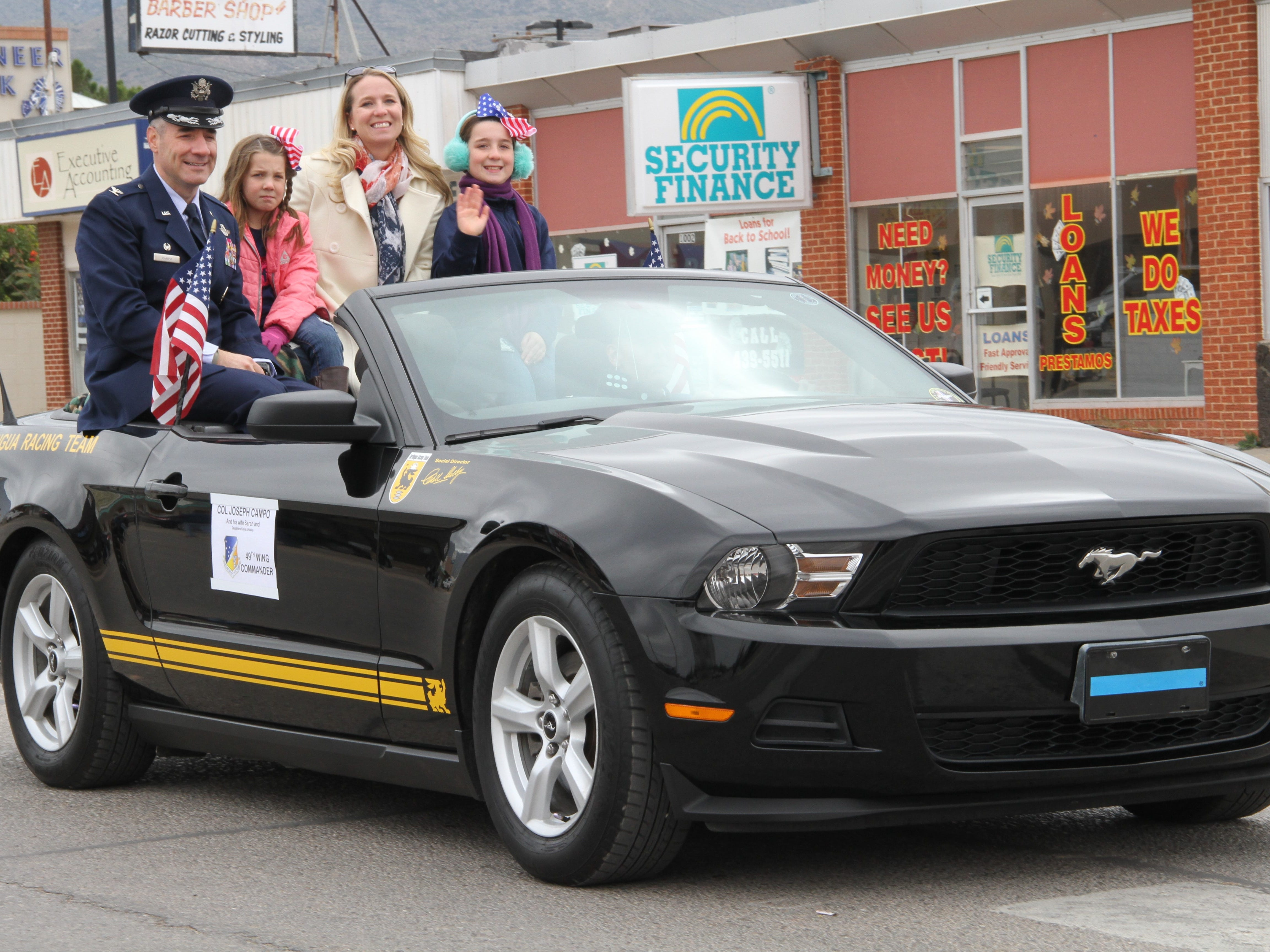 Holloman 49th Wing Commander Col. Joseph Campo, his wife Sarah and daughters Kayla and Hailey rode in the led vehicle at Alamogordo's Veterans Day Parade Saturday.