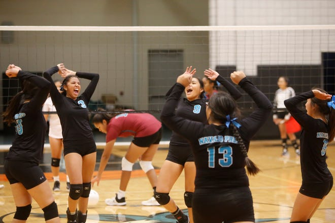 Navajo Prep celebrates a point against Shiprock during a non-district match on Thursday, Sept. 27 at the Eagles Nest. The Lady Eagles are 20-2 entering the 3A state tournament.