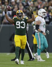 Green Bay Packers linebacker Reggie Gilbert (93) celebrates recovering a fumble in the first quarter against Miami Sunday, November 11, 2018, Lambeau Field in Green Bay, Wis.  Dan Powers/USA TODAY NETWORK-Wisconsin