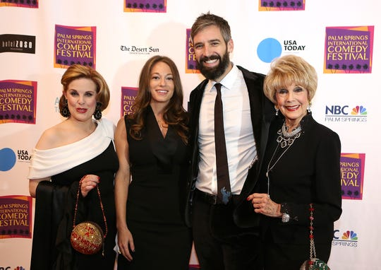 Actress Kat Kramer, left, writer-producer Erin Simms, writer, director and producer Bill Holderman, and actress Karen Sharpe Kramer arrive on the red carpet at the Palm Springs International Comedy Festival Awards Gala at Hotel Zoso in Palm Springs.