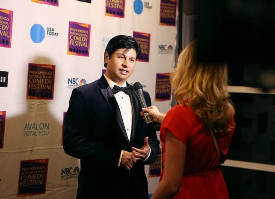 Paul Cruz, founder and director of the Palm Springs International Comedy Festival, speaks to a reporter on the red carpet before the festivals' awards gala at Hotel Zoso in Palm Springs.