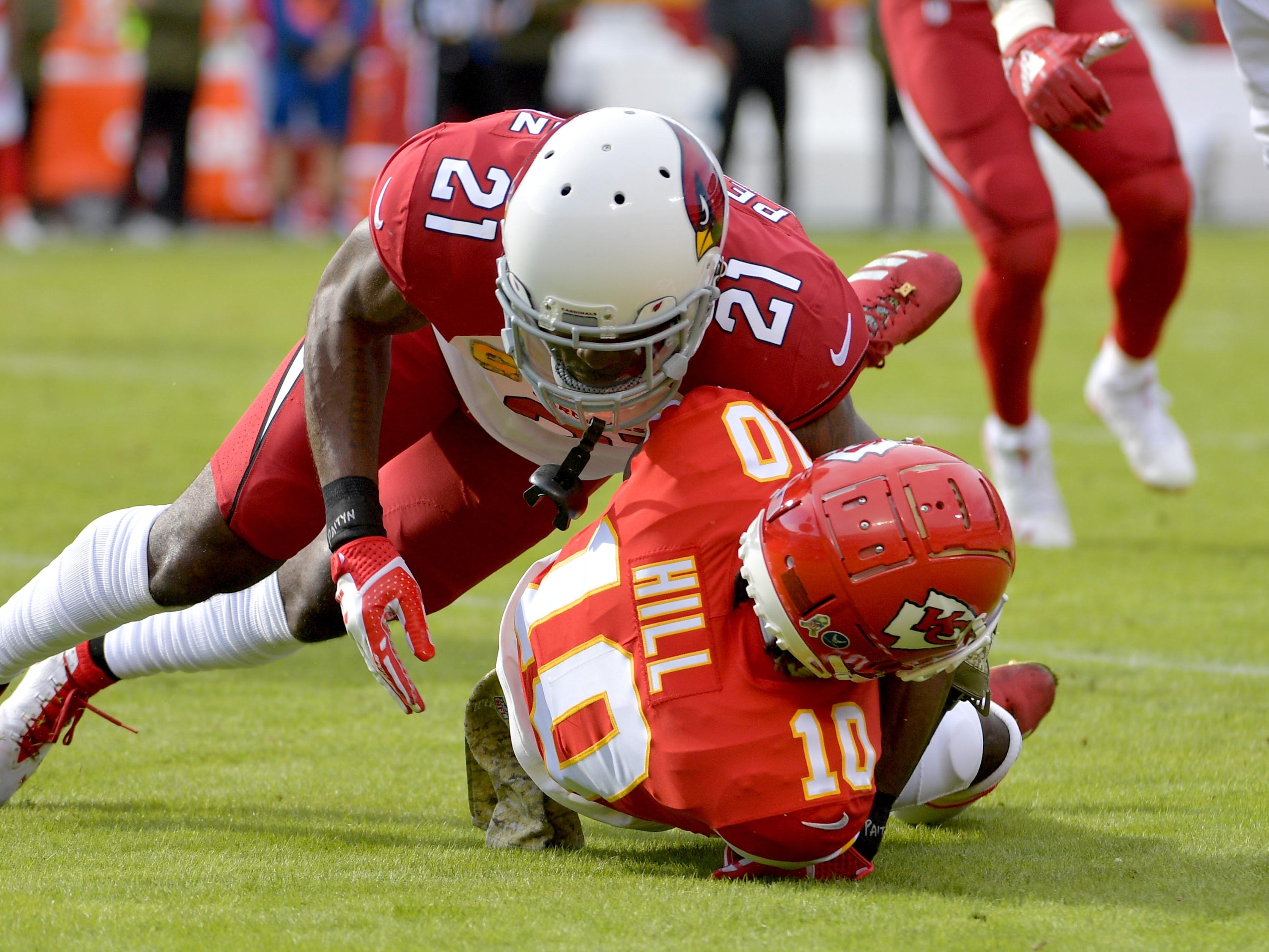 Nov 11, 2018; Kansas City, MO, USA; Kansas City Chiefs wide receiver Tyreek Hill (10) is tackled by Arizona Cardinals cornerback Patrick Peterson (21) during the first half at Arrowhead Stadium. Mandatory Credit: Denny Medley-USA TODAY Sports