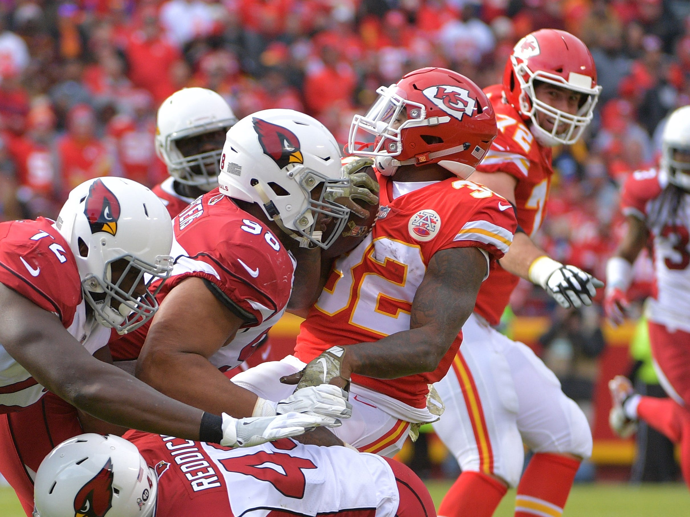 Nov 11, 2018; Kansas City, MO, USA; Kansas City Chiefs running back Spencer Ware (32) is tackled by Arizona Cardinals defensive tackle Corey Peters (98) during the first half at Arrowhead Stadium. Mandatory Credit: Denny Medley-USA TODAY Sports