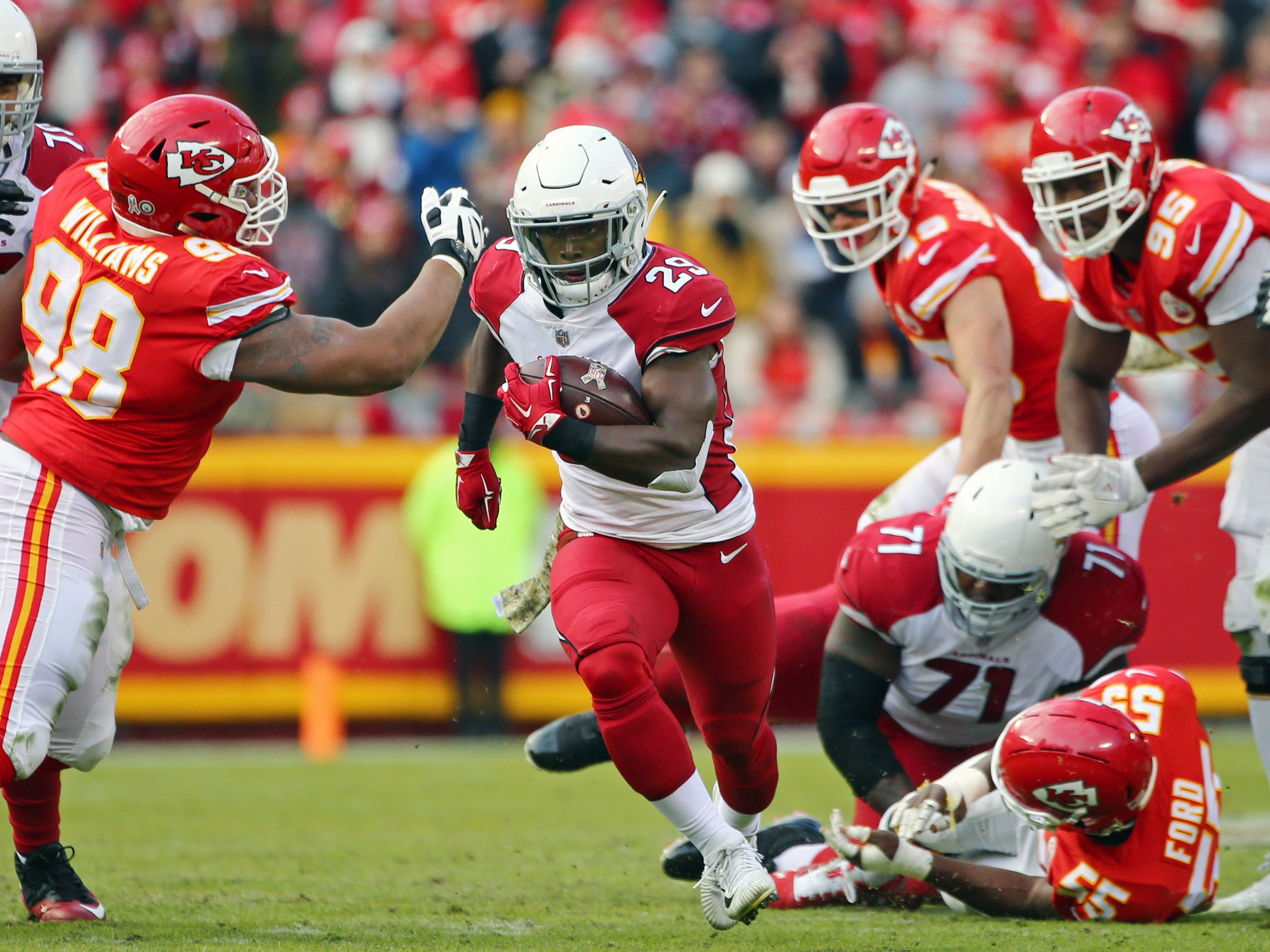 Nov 11, 2018; Kansas City, MO, USA; Arizona Cardinals running back Chase Edmonds (29) runs against Kansas City Chiefs defensive tackle Xavier Williams (98) in the second half at Arrowhead Stadium. Mandatory Credit: Jay Biggerstaff-USA TODAY Sports