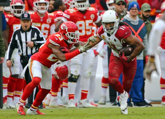 Cardinals receiver Larry Fitzgerald tries to escape Chiefs cornerback Kendall Fuller during a game Nov. 11 at Arrowhead Stadium.