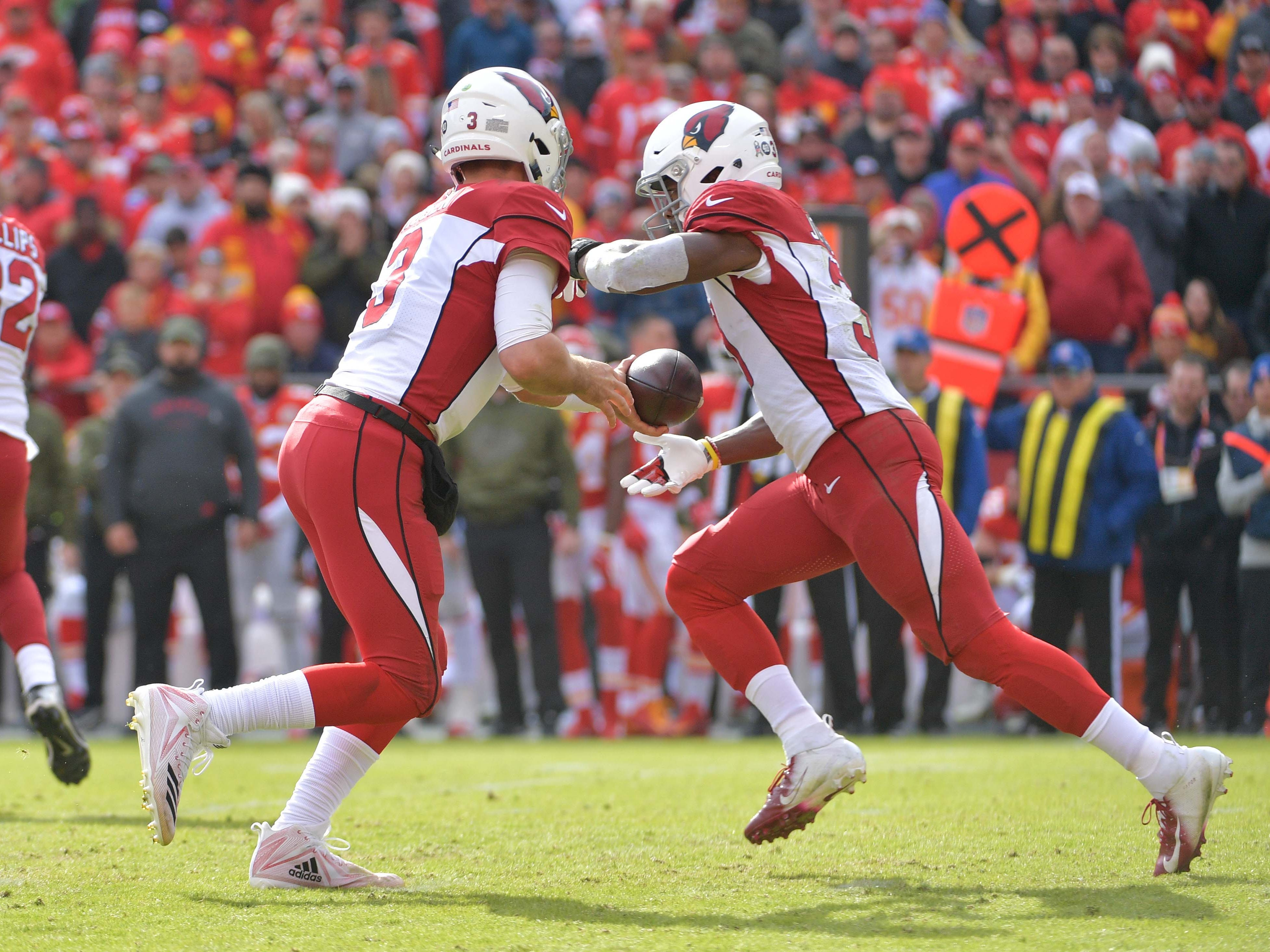 Nov 11, 2018; Kansas City, MO, USA; Arizona Cardinals quarterback Josh Rosen (3) hands off to running back David Johnson (31) during the first half against the Kansas City Chiefs at Arrowhead Stadium. Mandatory Credit: Denny Medley-USA TODAY Sports