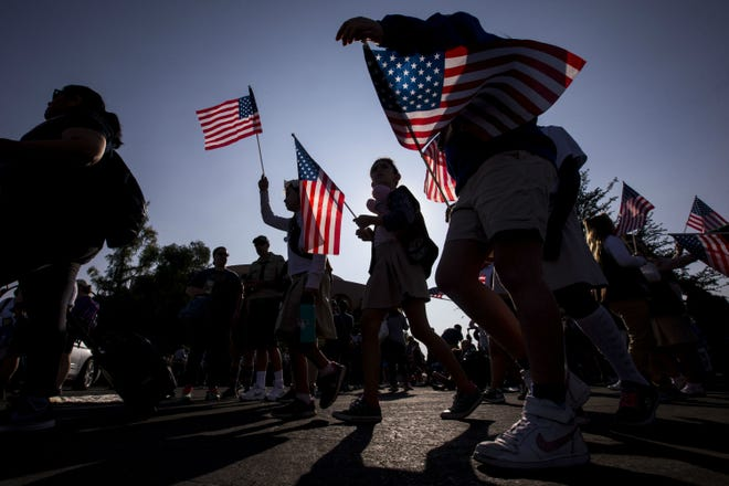 Parade participants gather before the Veterans Day Parade on Nov. 11, 2018, in Tempe, Ariz.