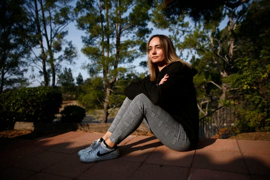 Ashley Daily, 21, a senior at USC, lives one-half mile from the mass shooting scene on Saturday, Nov. 10, 2018, in Thousand Oaks, Calif. Daily's high school girlfriend was killed at the shooting and a work colleague's home burned down last night in Woolsey Fire in Malibu last night. Twelve people were shot and killed Wednesday by gunman Ian David Long who opened fire at the Borderline Bar and Grill.