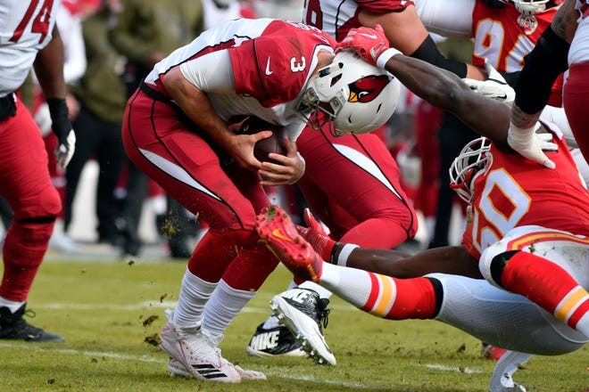 Arizona Cardinals quarterback Josh Rosen (3) escapes a tackle attempt by Kansas City Chiefs linebacker Justin Houston (50) during the first half of an NFL football game in Kansas City, Mo., Sunday, Nov. 11, 2018.