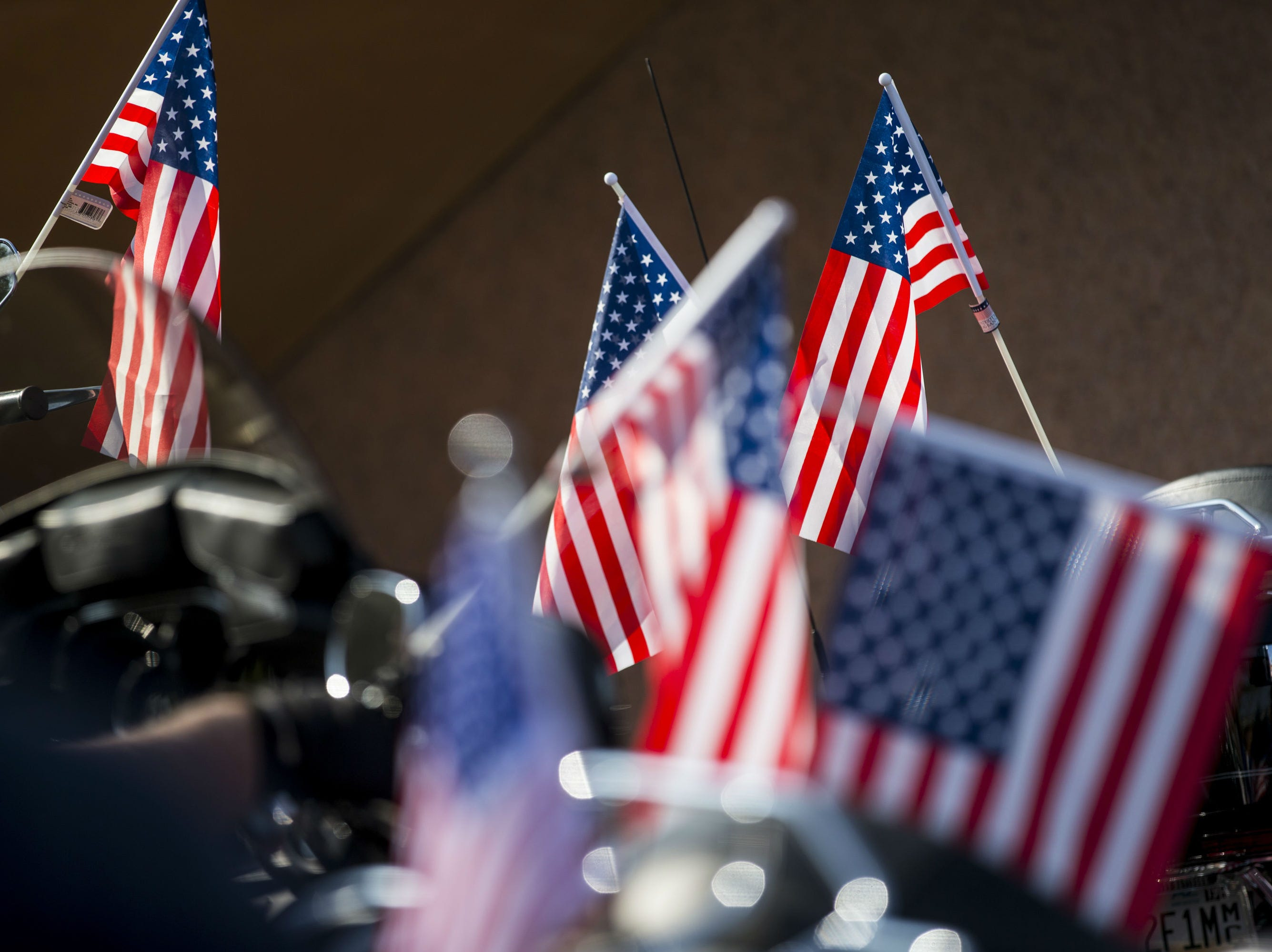 American flags are pictured on motorcycles before the Veterans Day Parade on Nov. 11, 2018, in Tempe, Ariz.