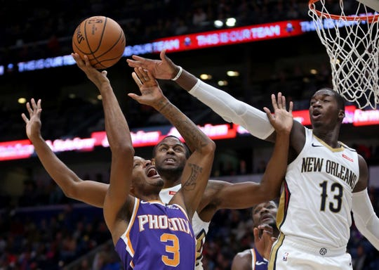 Nov 10, 2018; New Orleans, LA, USA; Phoenix Suns forward Trevor Ariza (3) is defended by New Orleans Pelicans forwards Darius Miller (21) and Cheick Diallo (13) in the first quarter at the Smoothie King Center. Mandatory Credit: Chuck Cook-USA TODAY Sports