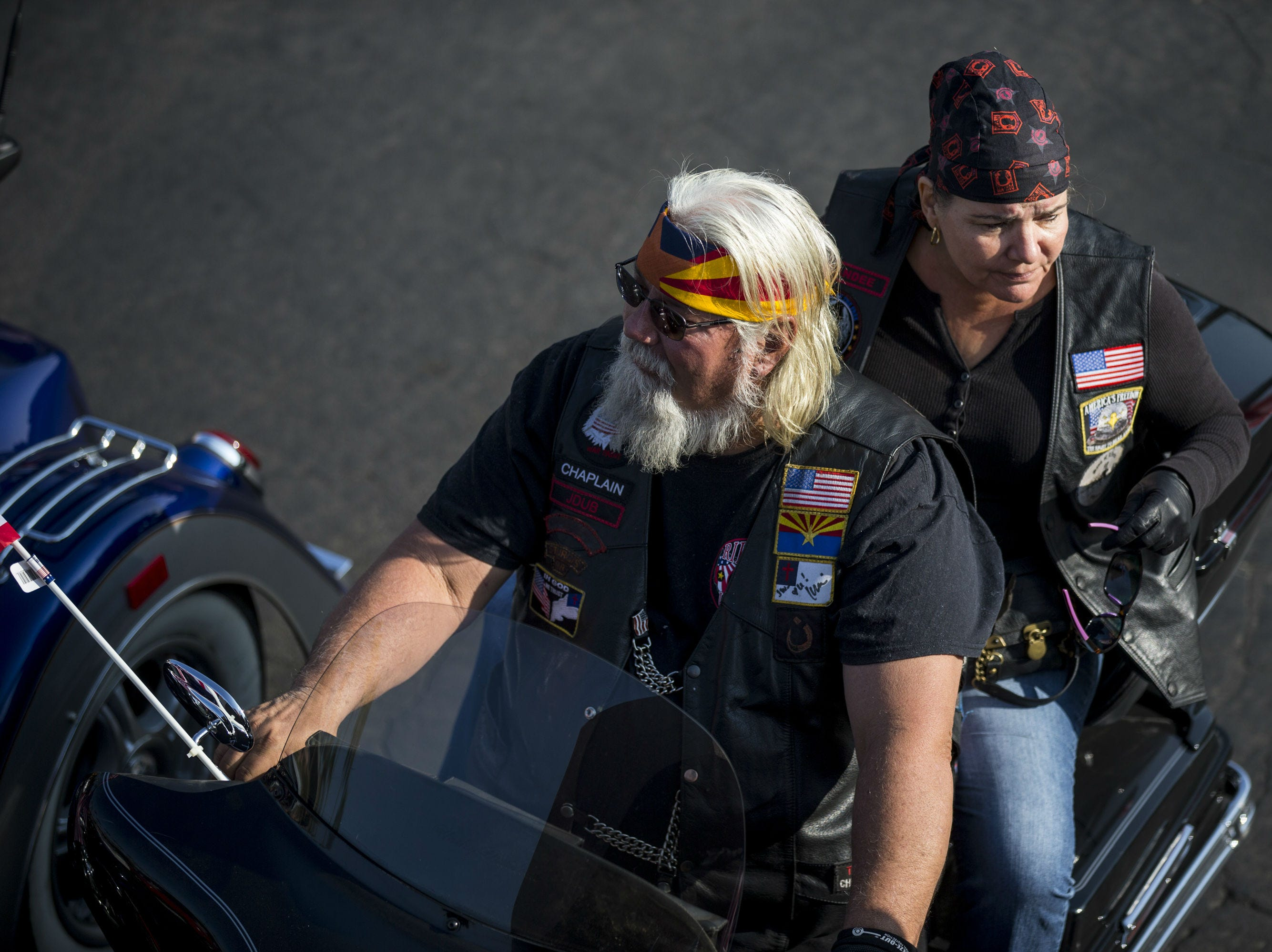 Jim Williams and Dandee, who only wanted to be identified by her first name, sit on their motorcycle before the Veterans Day Parade on Nov. 11, 2018, in Tempe, Ariz.