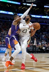 Nov 10, 2018; New Orleans, LA, USA; New Orleans Pelicans forward Anthony Davis (23) is foul by Phoenix Suns forward Richaun Holmes (21) in the first quarter at the Smoothie King Center. Mandatory Credit: Chuck Cook-USA TODAY Sports