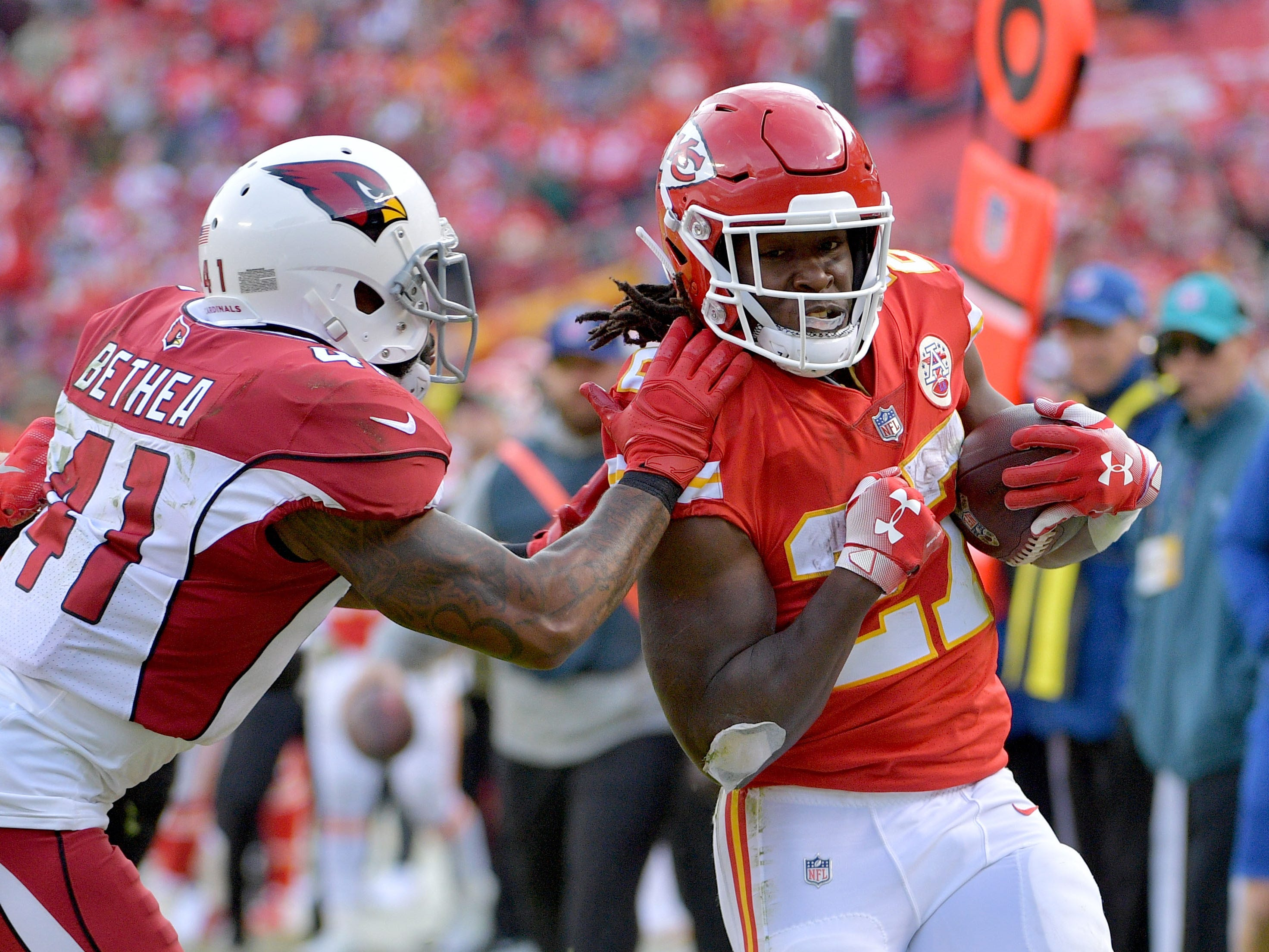 Nov 11, 2018; Kansas City, MO, USA; Kansas City Chiefs running back Kareem Hunt (27) runs the ball as Arizona Cardinals free safety Antoine Bethea (41) attempts the tackle during the second half at Arrowhead Stadium. The Chiefs won 26-14. Mandatory Credit: Denny Medley-USA TODAY Sports