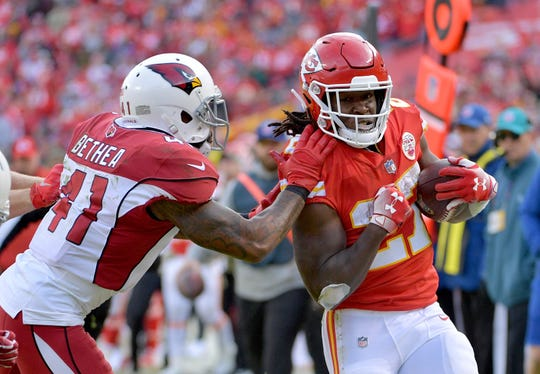 Antoine Bethea tries to bring down Chiefs running back Kareen Hunt during a game Nov. 11 at Arrowhead Stadium.