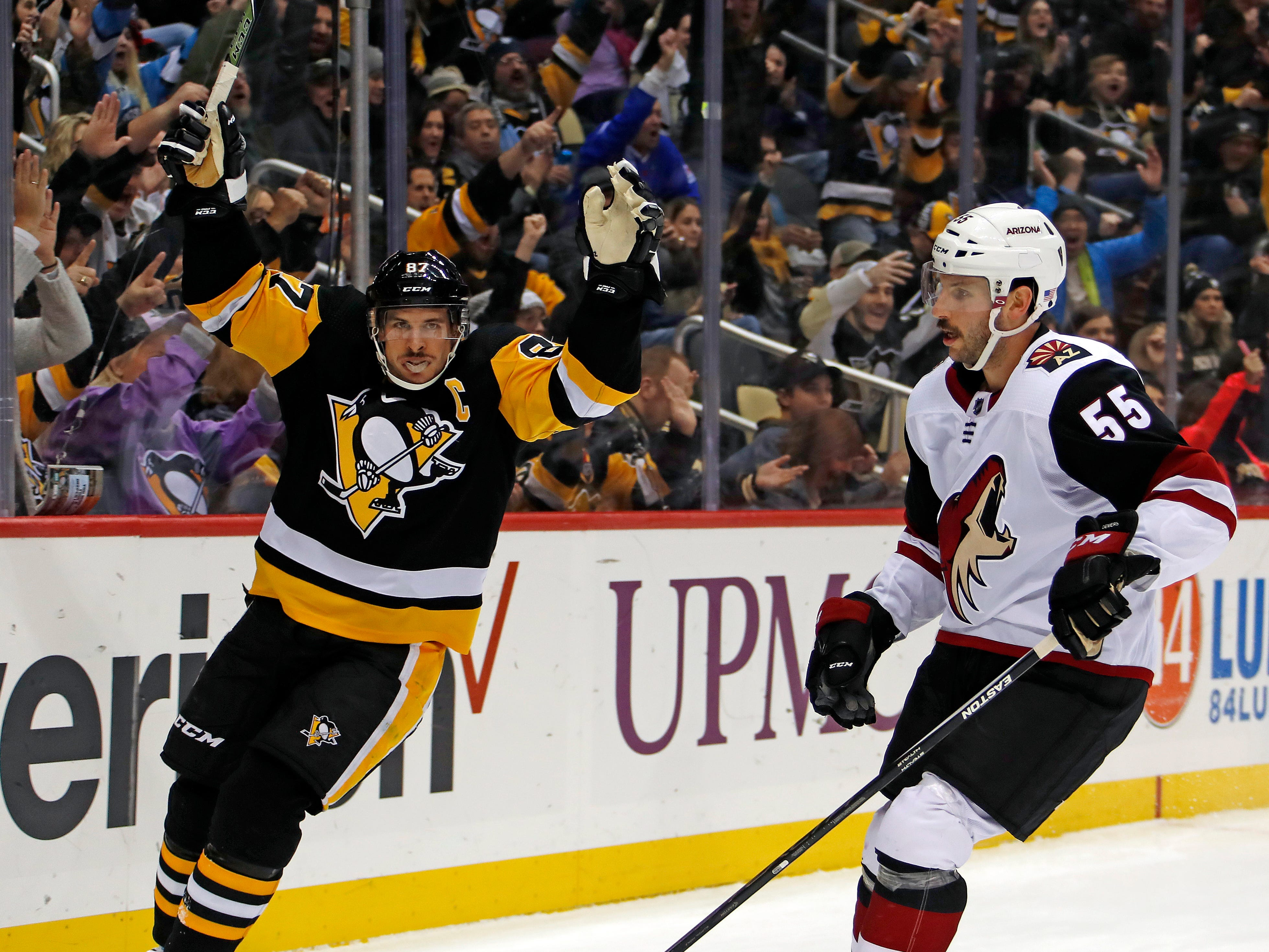 Pittsburgh Penguins' Sidney Crosby (87) celebrates his goal in front of Arizona Coyotes' Jason Demers (55) in the second period of an NHL hockey game in Pittsburgh, Saturday, Nov. 10, 2018. (AP Photo/Gene J. Puskar)