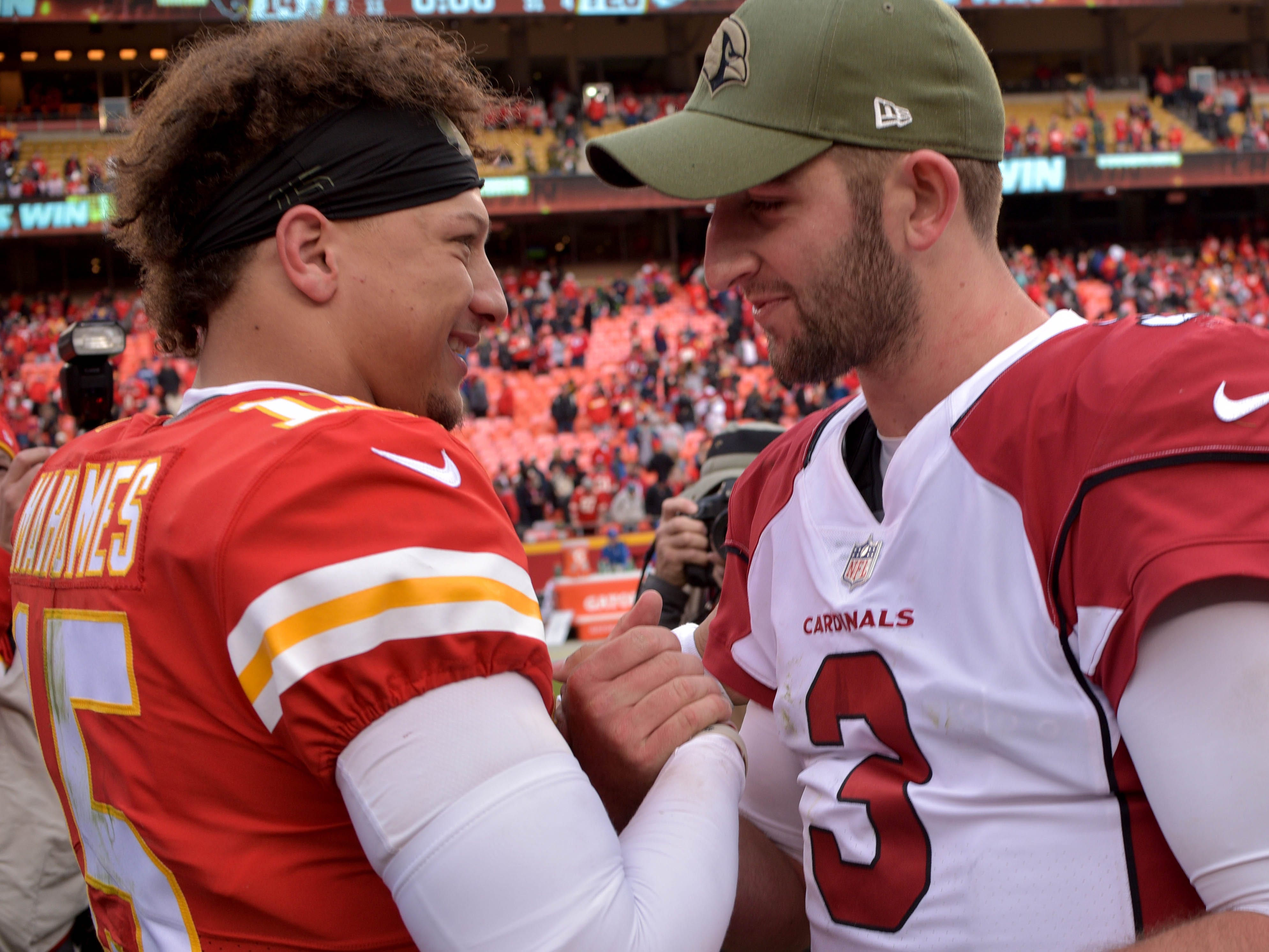 Nov 11, 2018; Kansas City, MO, USA; Kansas City Chiefs quarterback Patrick Mahomes (15) shakes hands with Arizona Cardinals quarterback Josh Rosen (3) after the game at Arrowhead Stadium. The Chiefs won 26-14. Mandatory Credit: Denny Medley-USA TODAY Sports
