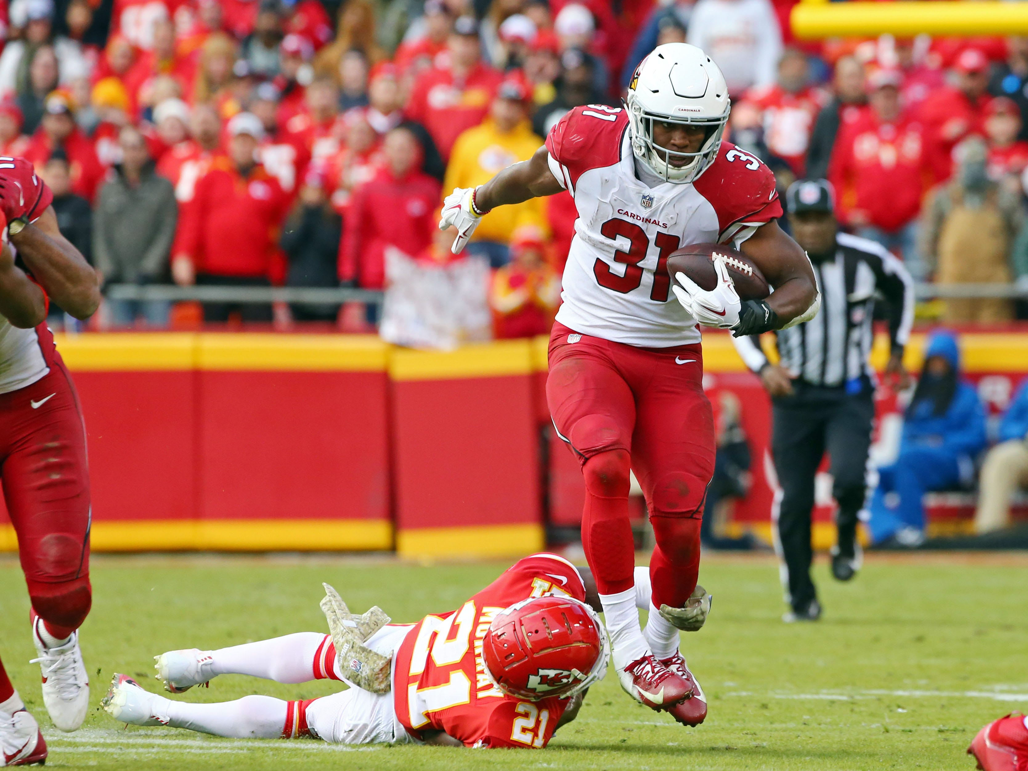 Nov 11, 2018; Kansas City, MO, USA; Arizona Cardinals running back David Johnson (31) is tackled by Kansas City Chiefs cornerback Eric Murray (21) in the second half at Arrowhead Stadium. Mandatory Credit: Jay Biggerstaff-USA TODAY Sports