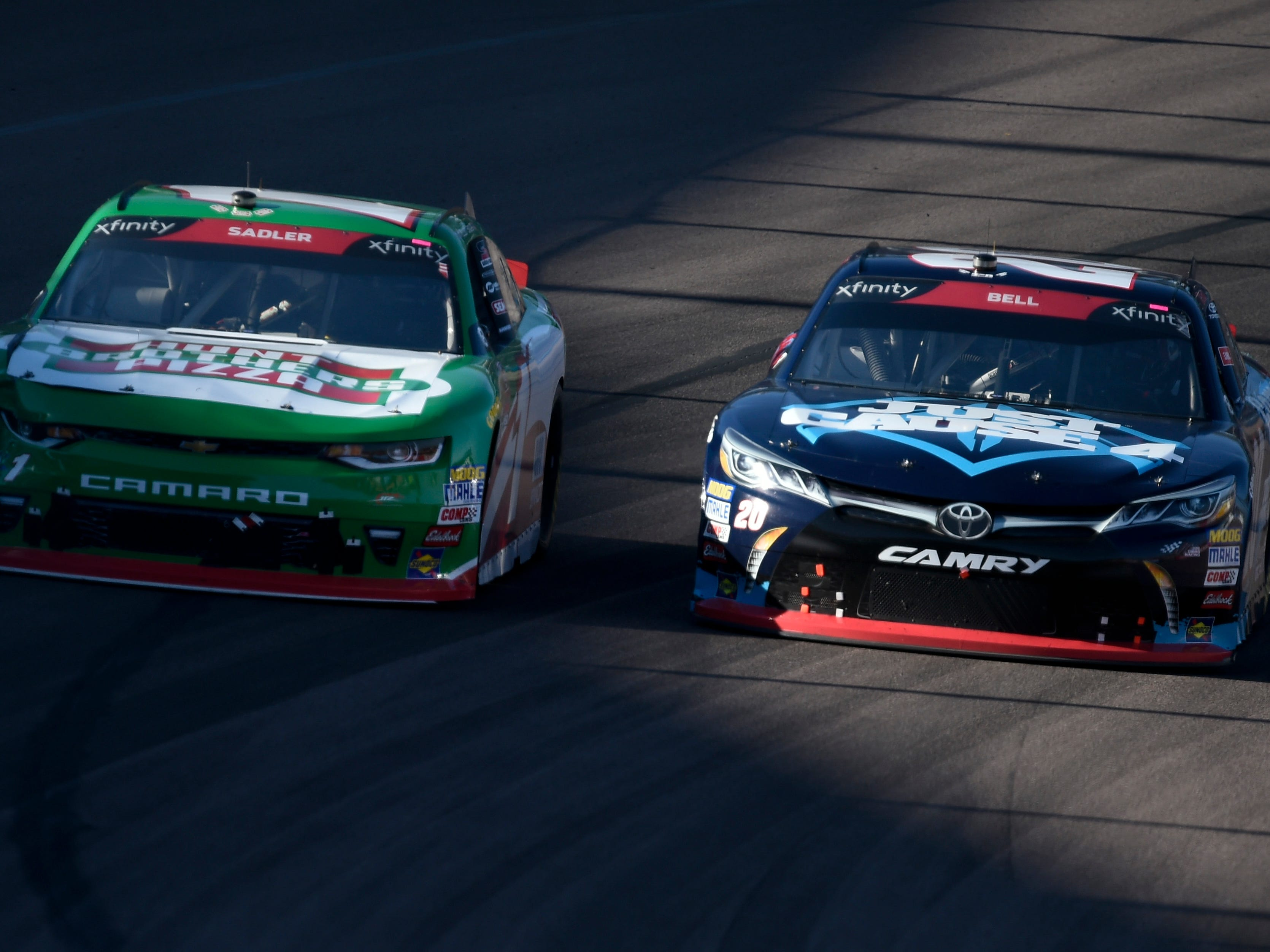 Nov 10, 2018; Avondale, AZ, USA; NASCAR Xfinity Series driver Christopher Bell (20) next to NASCAR Xfinity Series driver Elliott Sadler (1) during the NASCAR Xfinity Series Race at ISM Raceway. Mandatory Credit: Kelvin Kuo-USA TODAY Sports