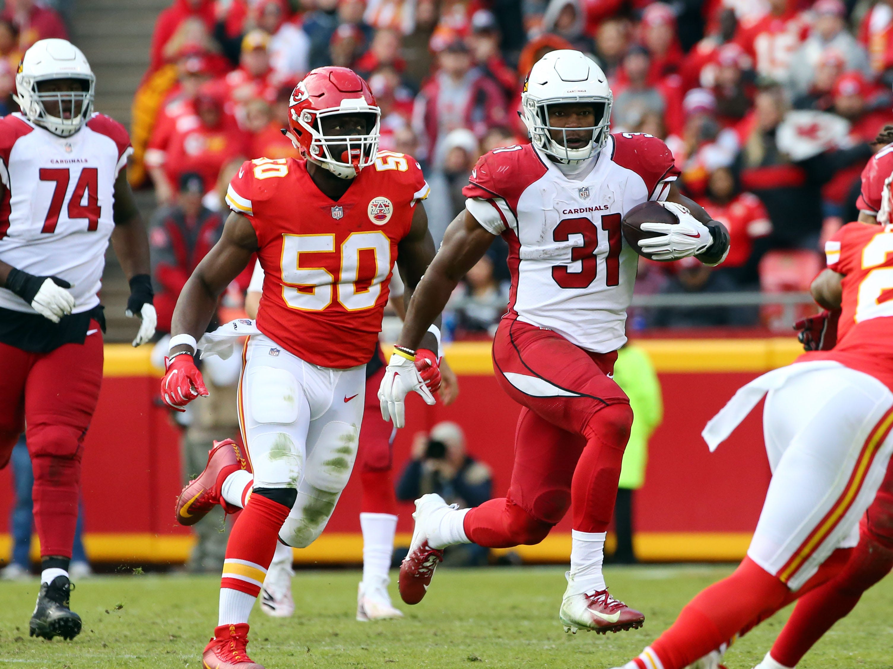 Nov 11, 2018; Kansas City, MO, USA; Arizona Cardinals running back David Johnson (31) runs past Kansas City Chiefs linebacker Justin Houston (50) in the second half at Arrowhead Stadium. Mandatory Credit: Jay Biggerstaff-USA TODAY Sports