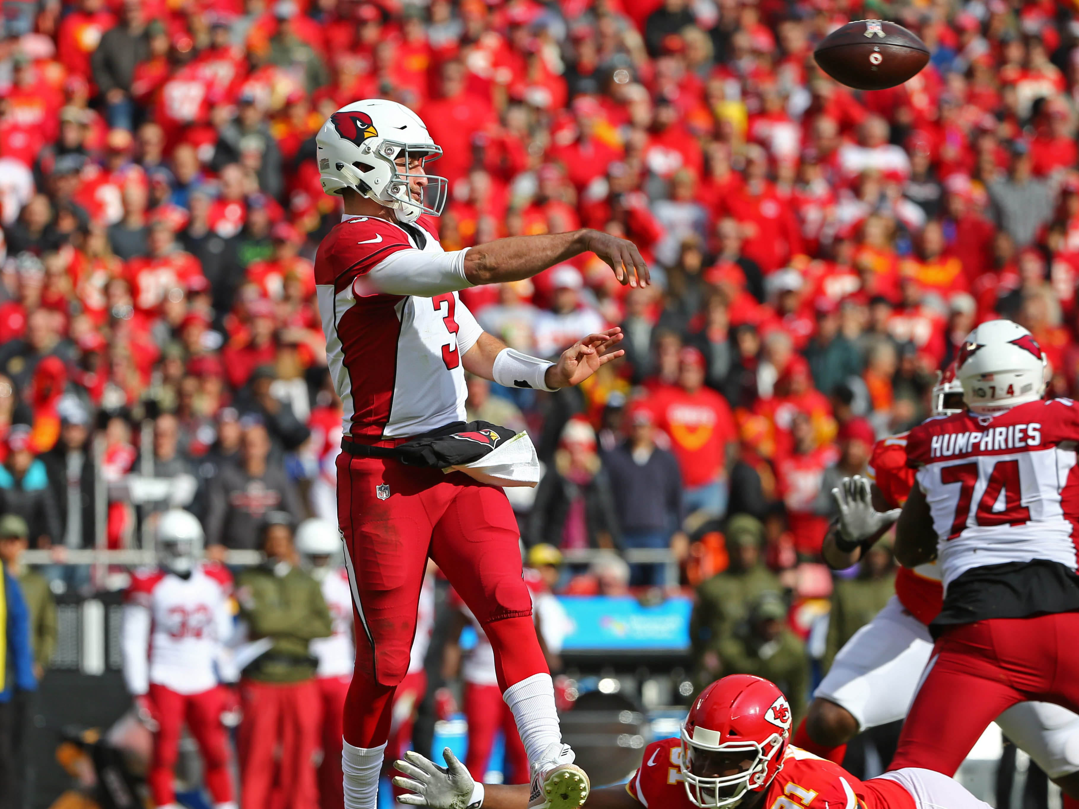 Nov 11, 2018; Kansas City, MO, USA; Arizona Cardinals quarterback Josh Rosen (3) throws a pass as Kansas City Chiefs defensive tackle Derrick Nnadi (91) defends in the first half at Arrowhead Stadium. Mandatory Credit: Jay Biggerstaff-USA TODAY Sports
