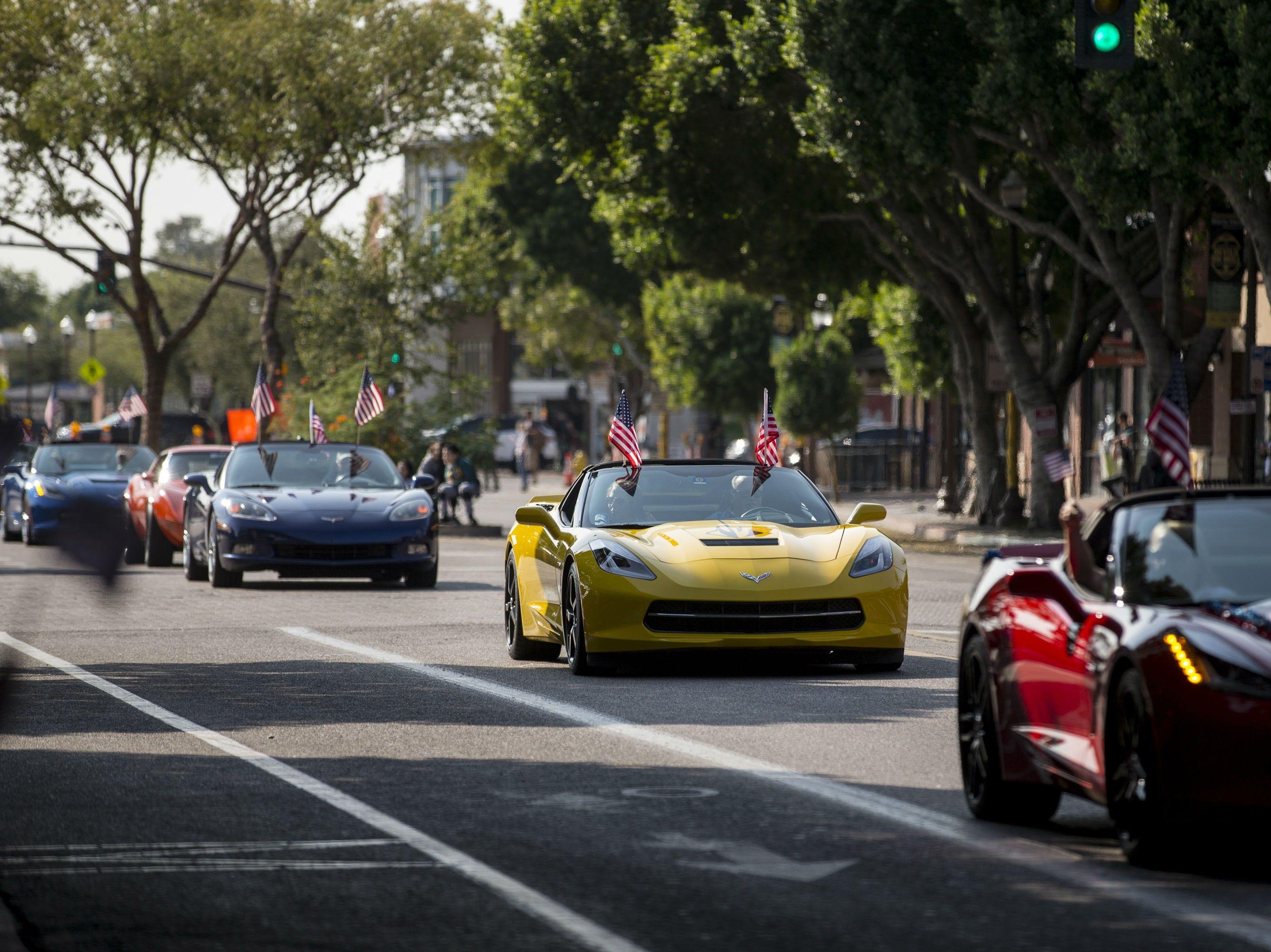 Corvettes drive down Mill Avenue during the Veterans Day Parade on Nov. 11, 2018, in Tempe, Ariz.