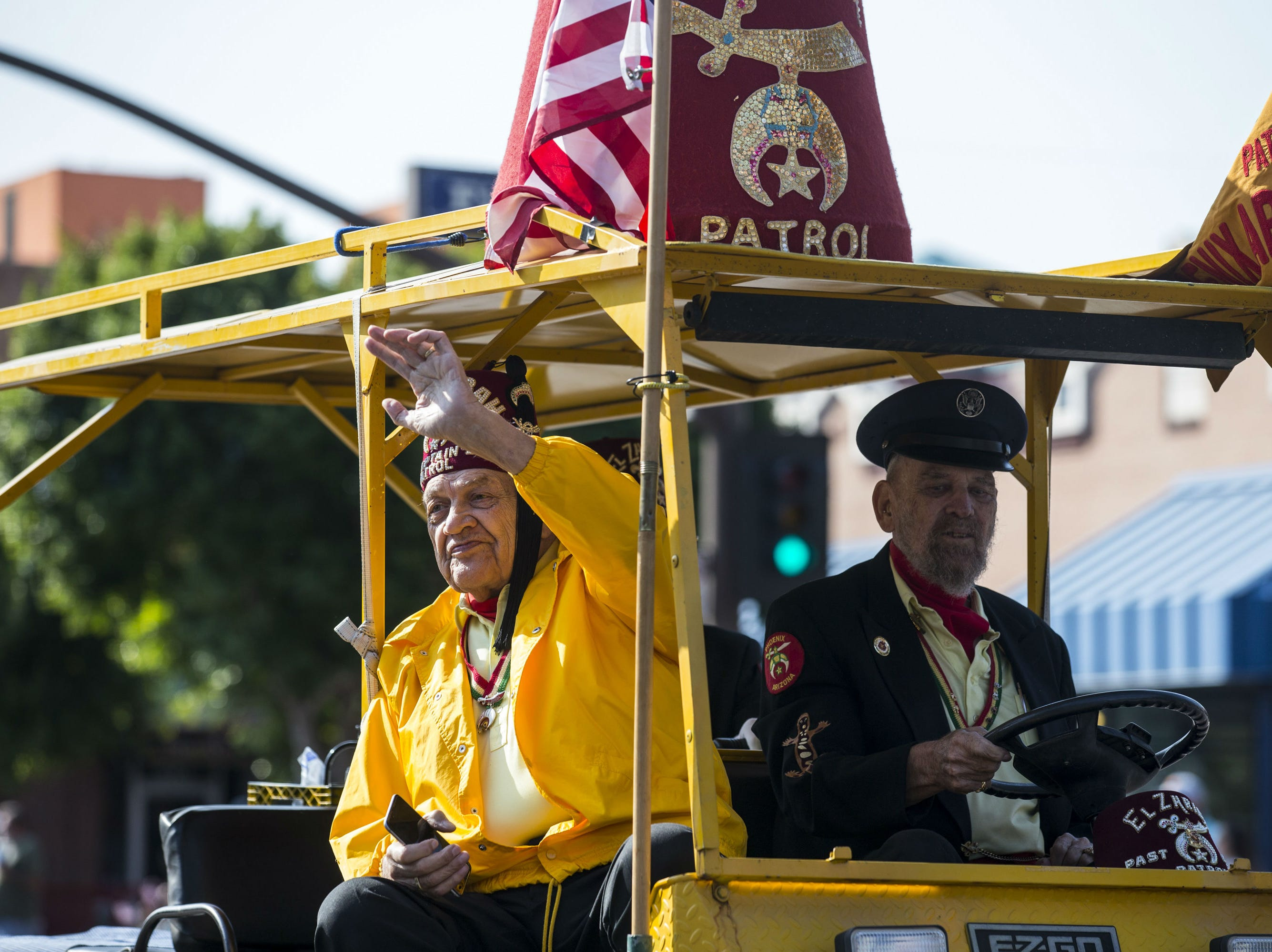 Shriners drive down Mill Avenue during the Veterans Day Parade on Nov. 11, 2018, in Tempe, Ariz.