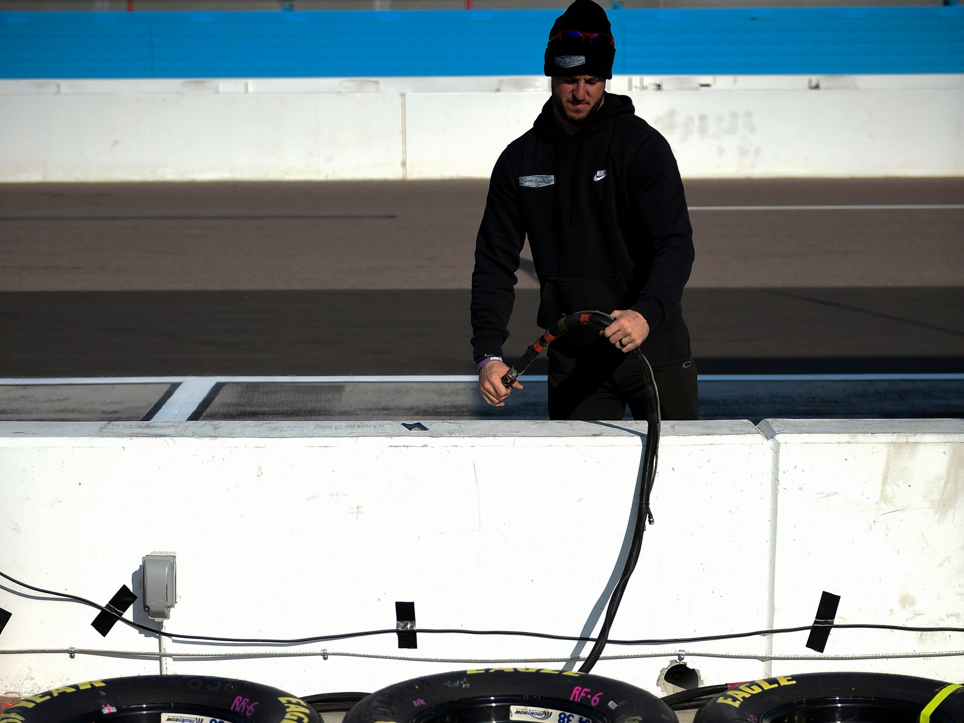 Nov 11, 2018; Avondale, AZ, USA; A crew member sets up the pit for Monster Energy NASCAR Cup Series driver William Byron (24) prior to the Can-Am 500 at ISM Raceway. Mandatory Credit: Kelvin Kuo-USA TODAY Sports