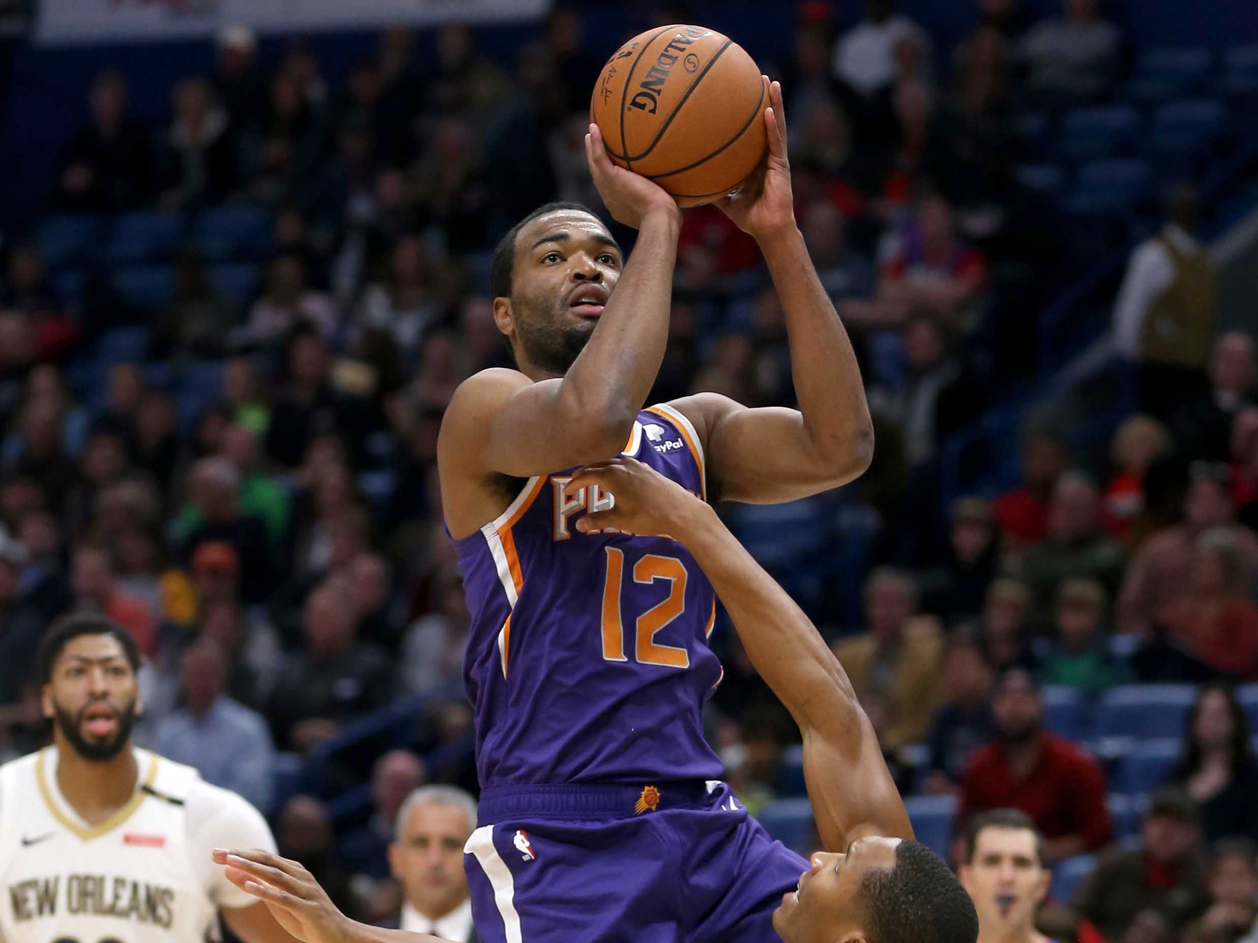 Nov 10, 2018; New Orleans, LA, USA; Phoenix Suns forward TJ Warren (12) shoots over New Orleans Pelicans forward Wesley Johnson (33) in the first quarter at the Smoothie King Center. Mandatory Credit: Chuck Cook-USA TODAY Sports