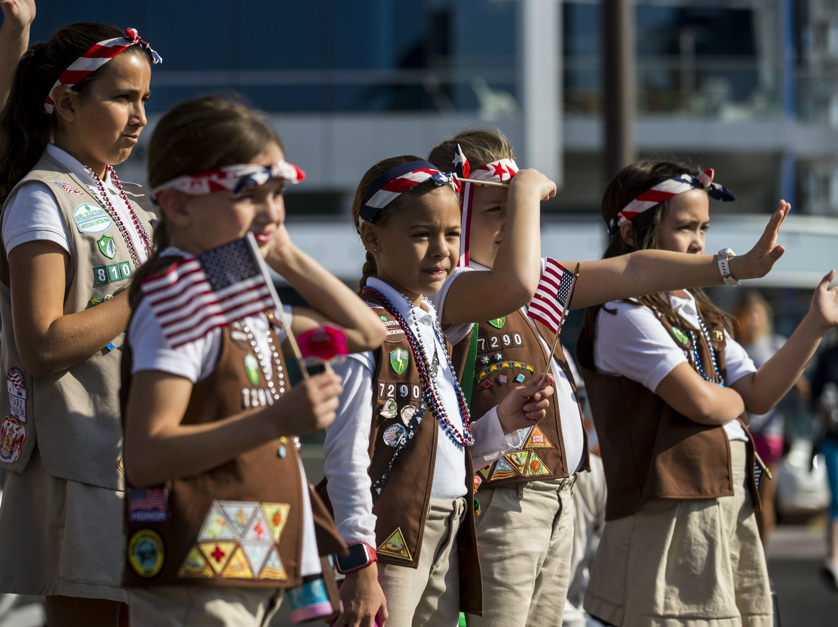 Girl Scouts watch the Veterans Day Parade on Nov. 11, 2018, in Tempe, Ariz.