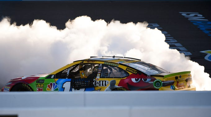 Nov 11, 2018; Avondale, AZ, USA; Monster Energy NASCAR Cup Series driver Kyle Busch (18) celebrates after winning the Can-Am 500 at ISM Raceway. Mandatory Credit: Kelvin Kuo-USA TODAY Sports