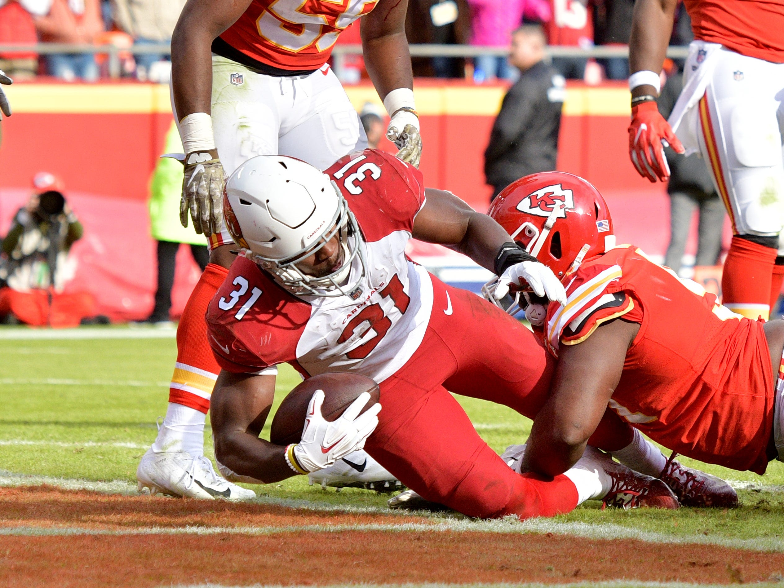 Nov 11, 2018; Kansas City, MO, USA; Arizona Cardinals running back David Johnson (31) scores a touchdown as Kansas City Chiefs nose tackle Derrick Nnadi (91) makes the tackle during the second half at Arrowhead Stadium. The Chiefs won 26-14. Mandatory Credit: Denny Medley-USA TODAY Sports